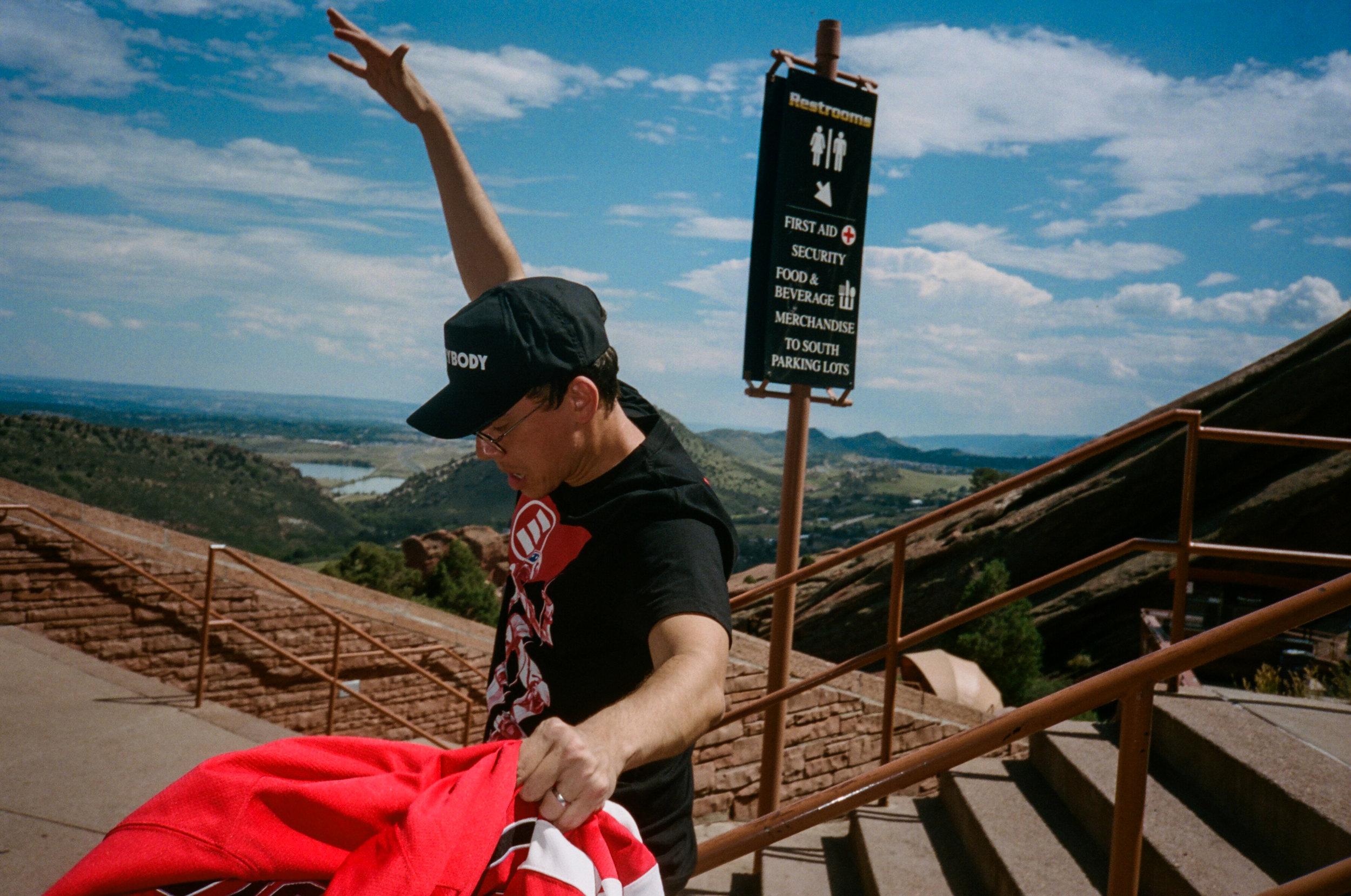 Bob sliding down a railing at Red Rocks