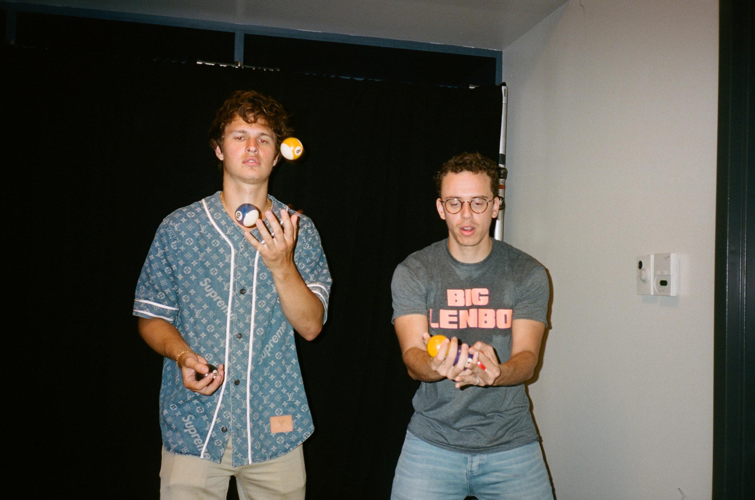 Ansel Elgort and Bob try and juggle pool balls.