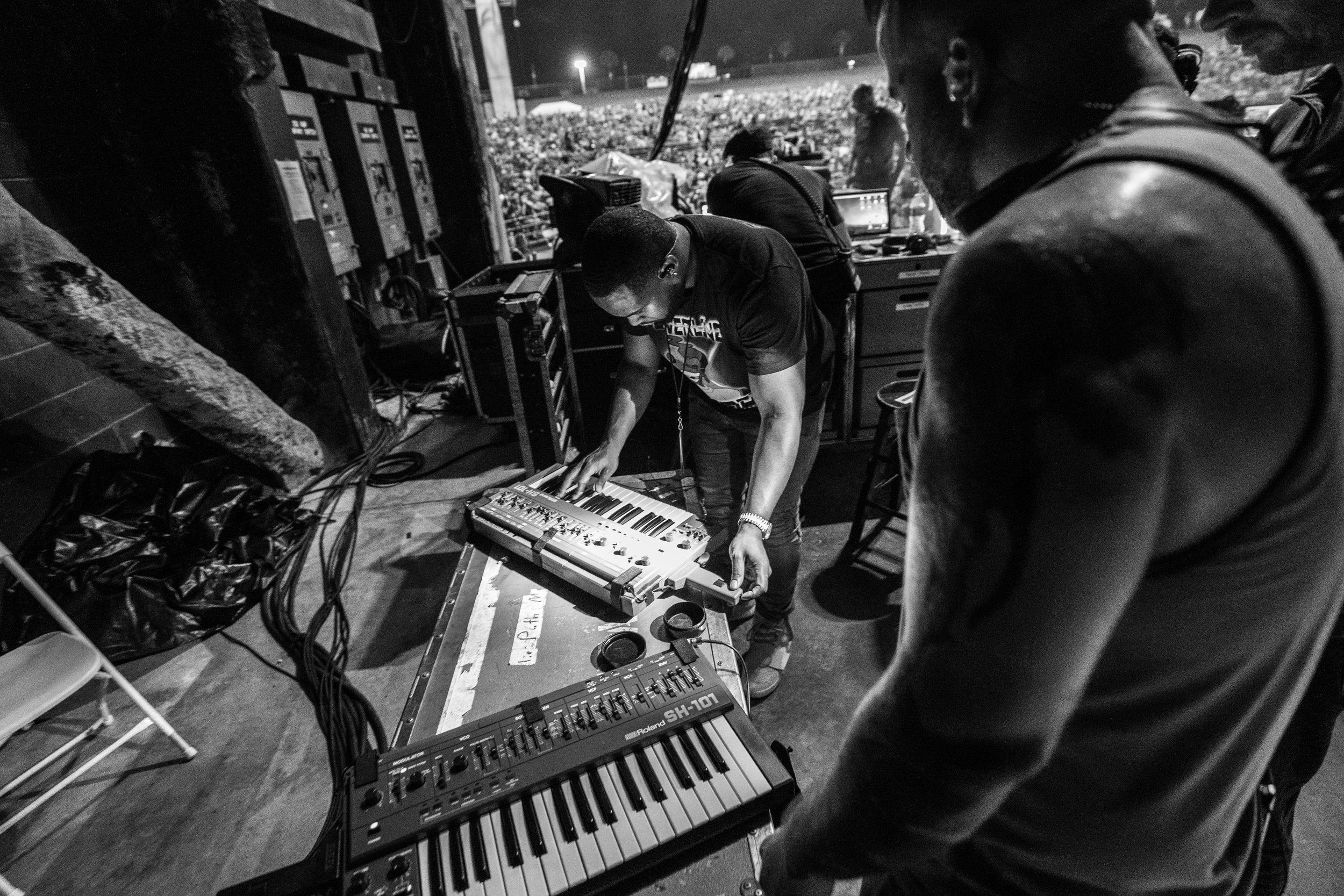 Darek Cobbs tuning Charlie's Keytar before a show in Tampa, 2018