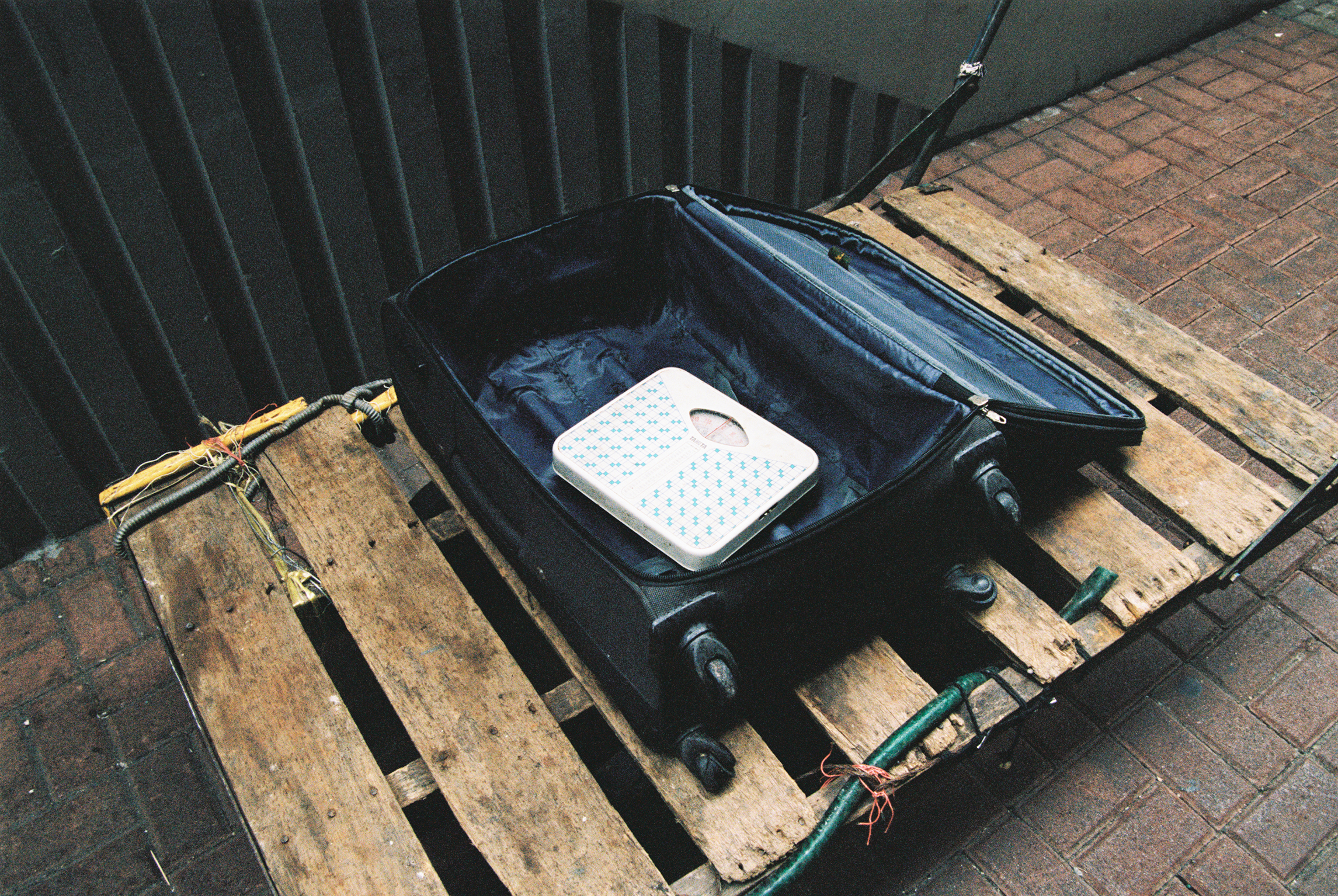 A Scale, In a Suitcase, On a Crate