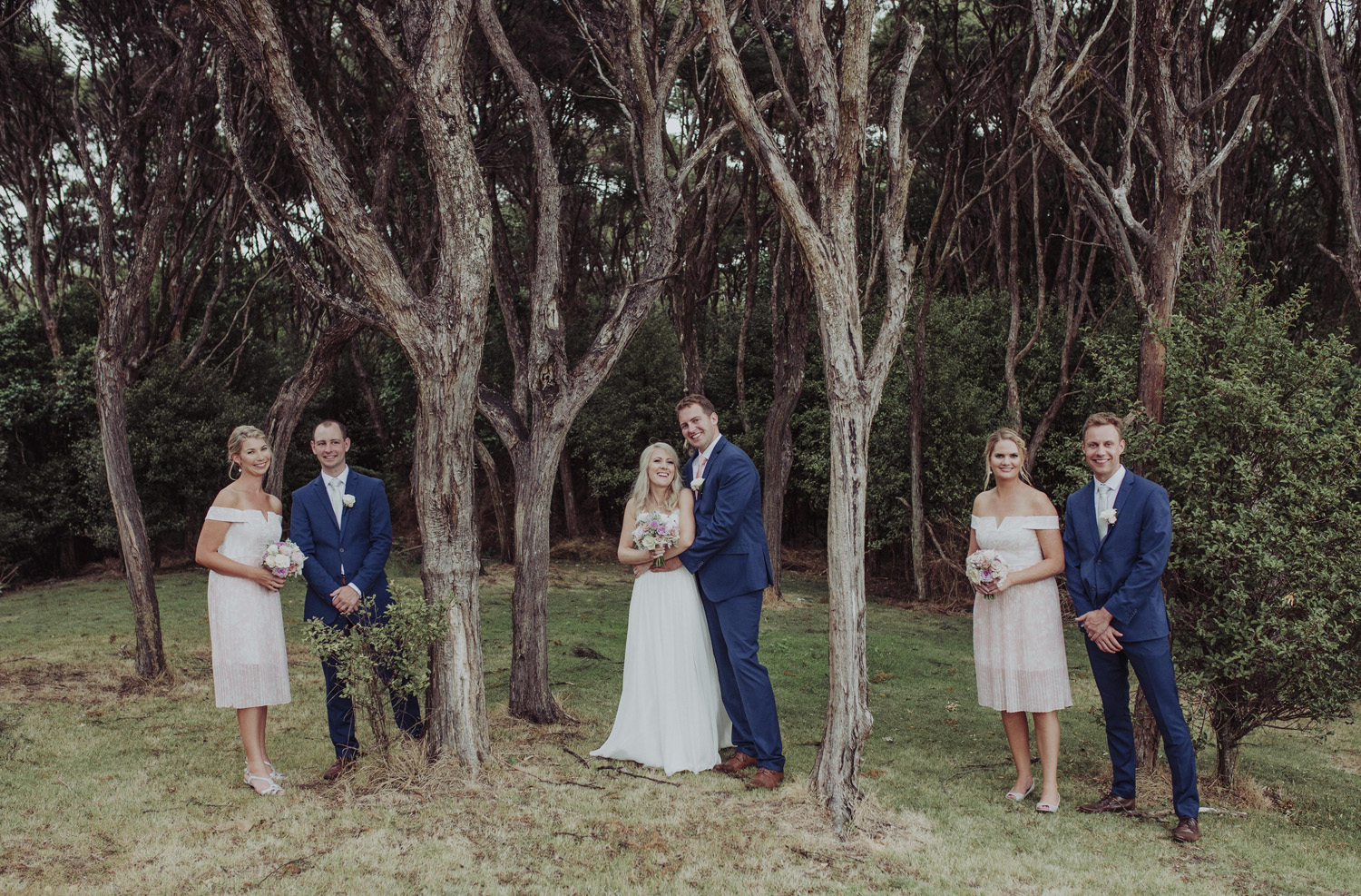 Bridal party in woods at Mudbrick wedding photo