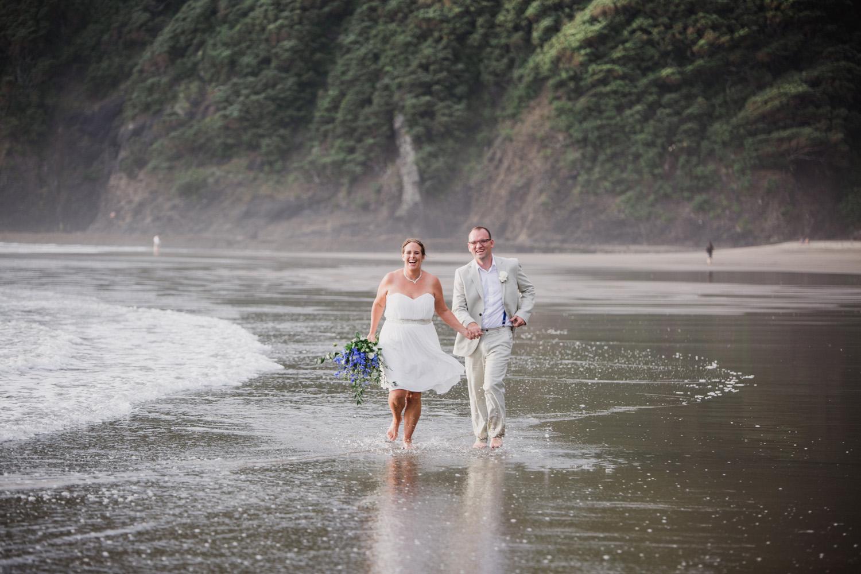 Bride and groom wedding photo at North Piha beach
