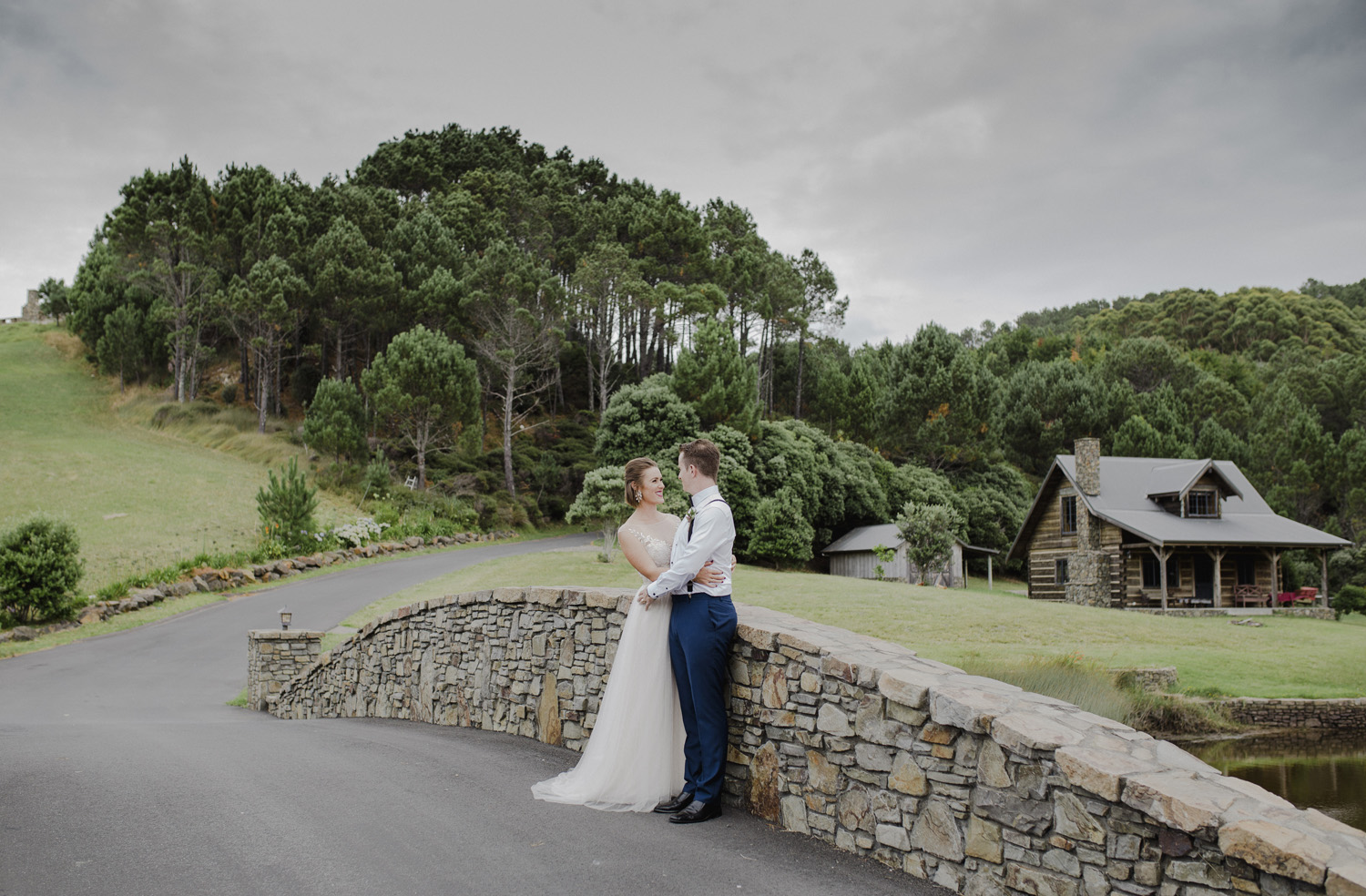 Bride and groom at bridge at Leadfoot Ranch wedding