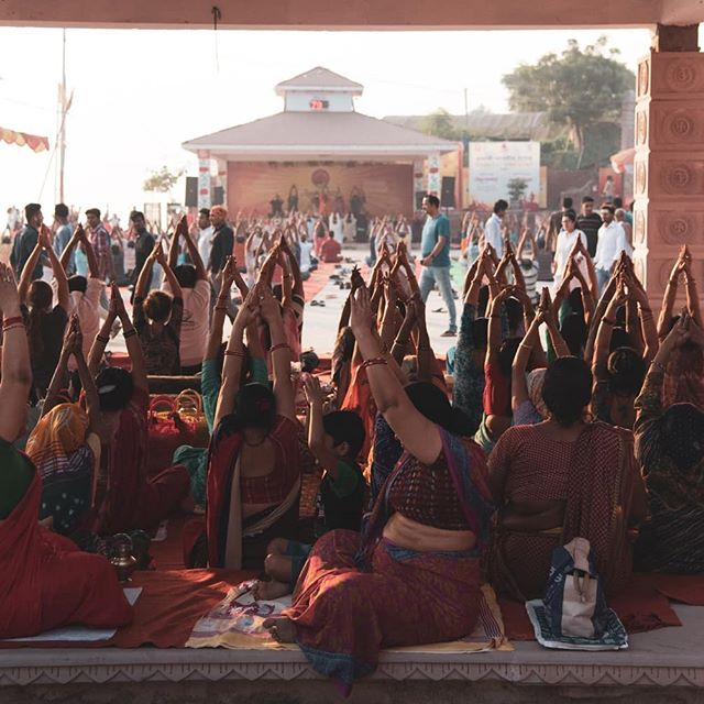 Shortly after sunrise in #Varanasi , thousands gather for communal yoga.