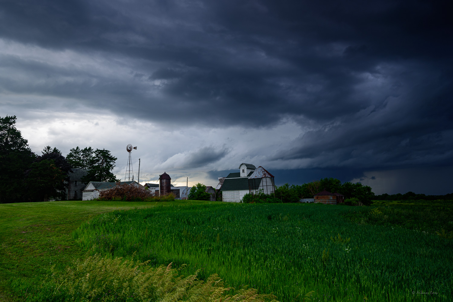 Farm on a hill with clouds, near Sherrill, Iowa