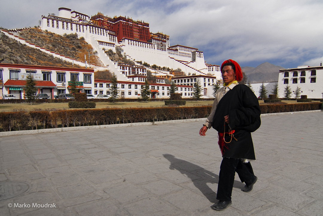 Pilgrim in front of the Potala Palace, Lhasa