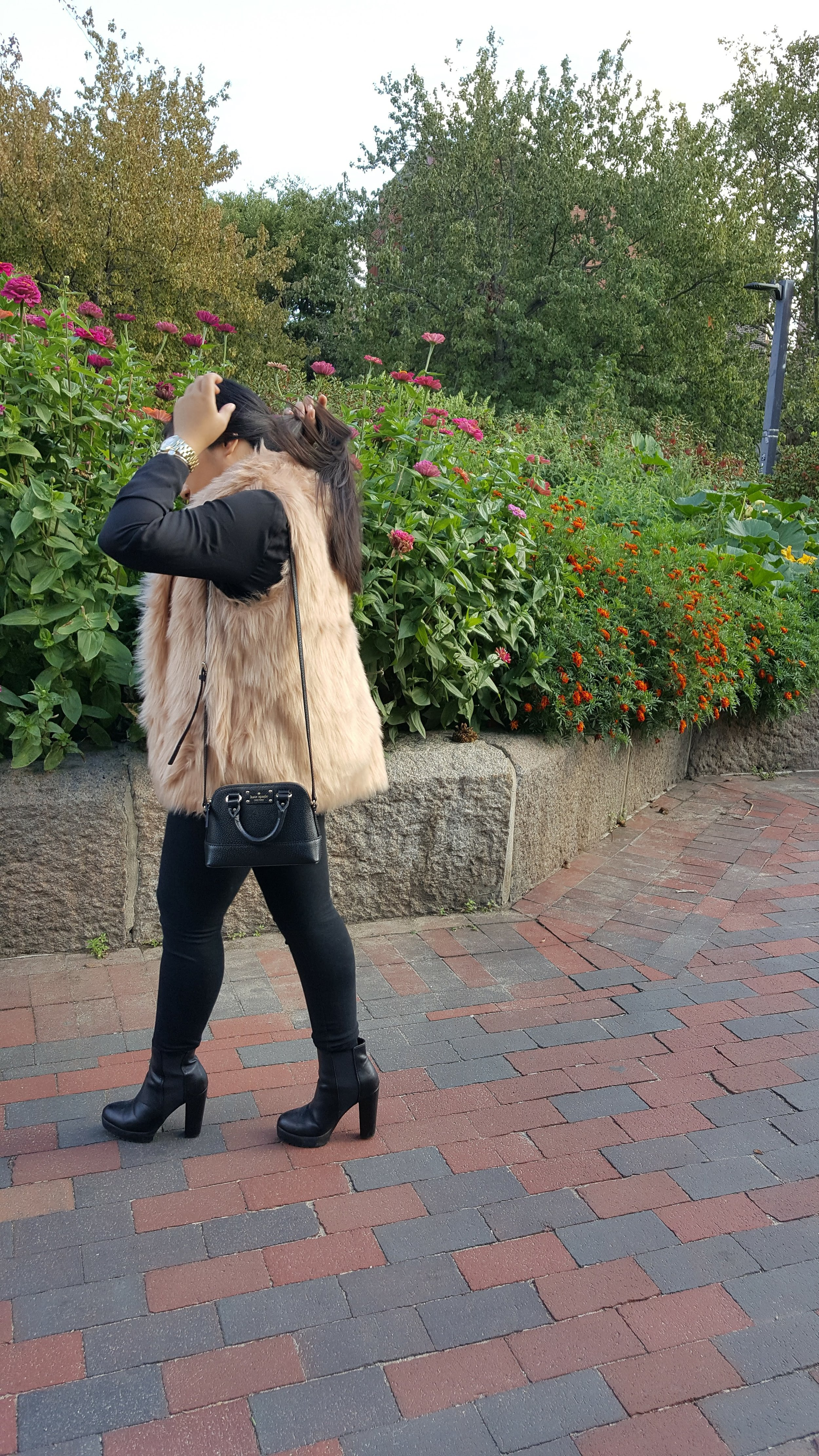 this is yna faux fur vest side view