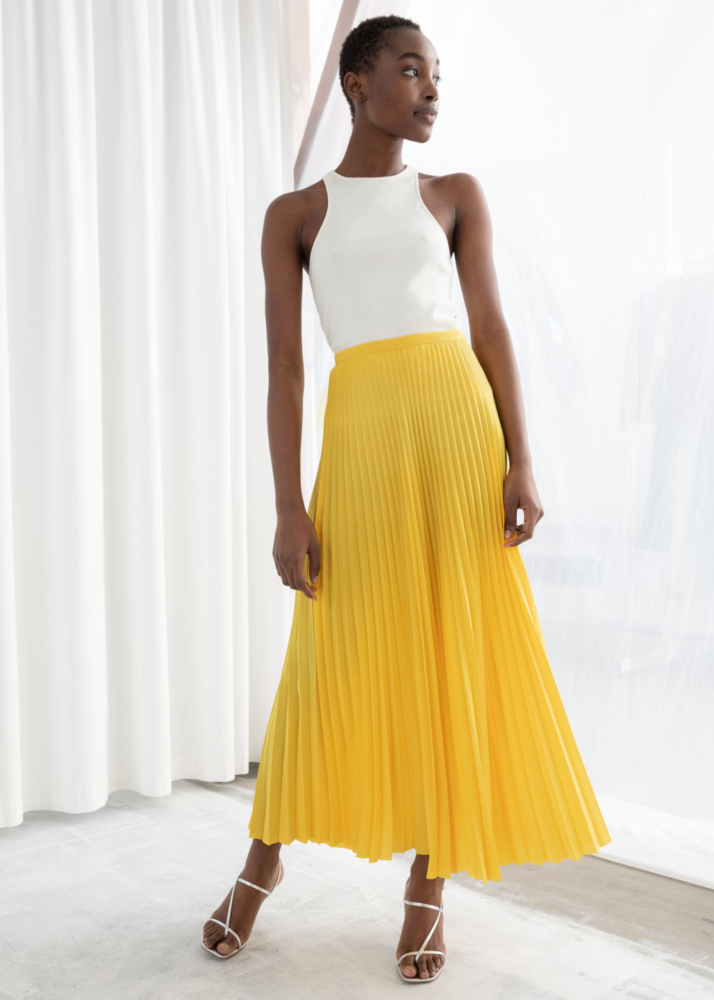 & Other Stories Pleated Midi Skirt - $89.00I have a dress from & Other Stories in this same sunshiney yellow that I love, so of course I was drawn to this golden pleated skirt of theirs. For a while I wasn't too keen on wearing yellow because of my skin tone, but I've been learning to like it since last summer – so long as there's not too much of a green undertone to the yellow.