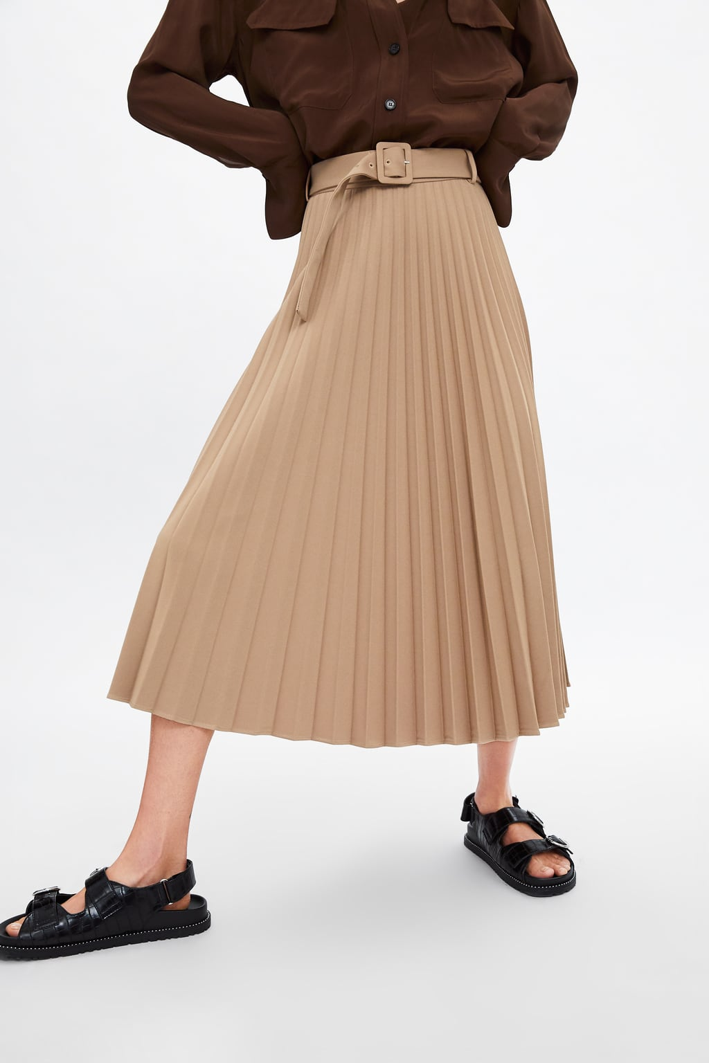 ZARA Belted Pleated Skirt - $69.90I am really digging the belt detail on this skirt and I was also pulled in by the I'm-going-to-explore-a-jungle-in-the-Philippines vibe that Zara styled it in. There are a lot of 60s/ mod/retro belted looks out right now, so this skirt is a perfect way to pull that style into your summer wardrobe.
