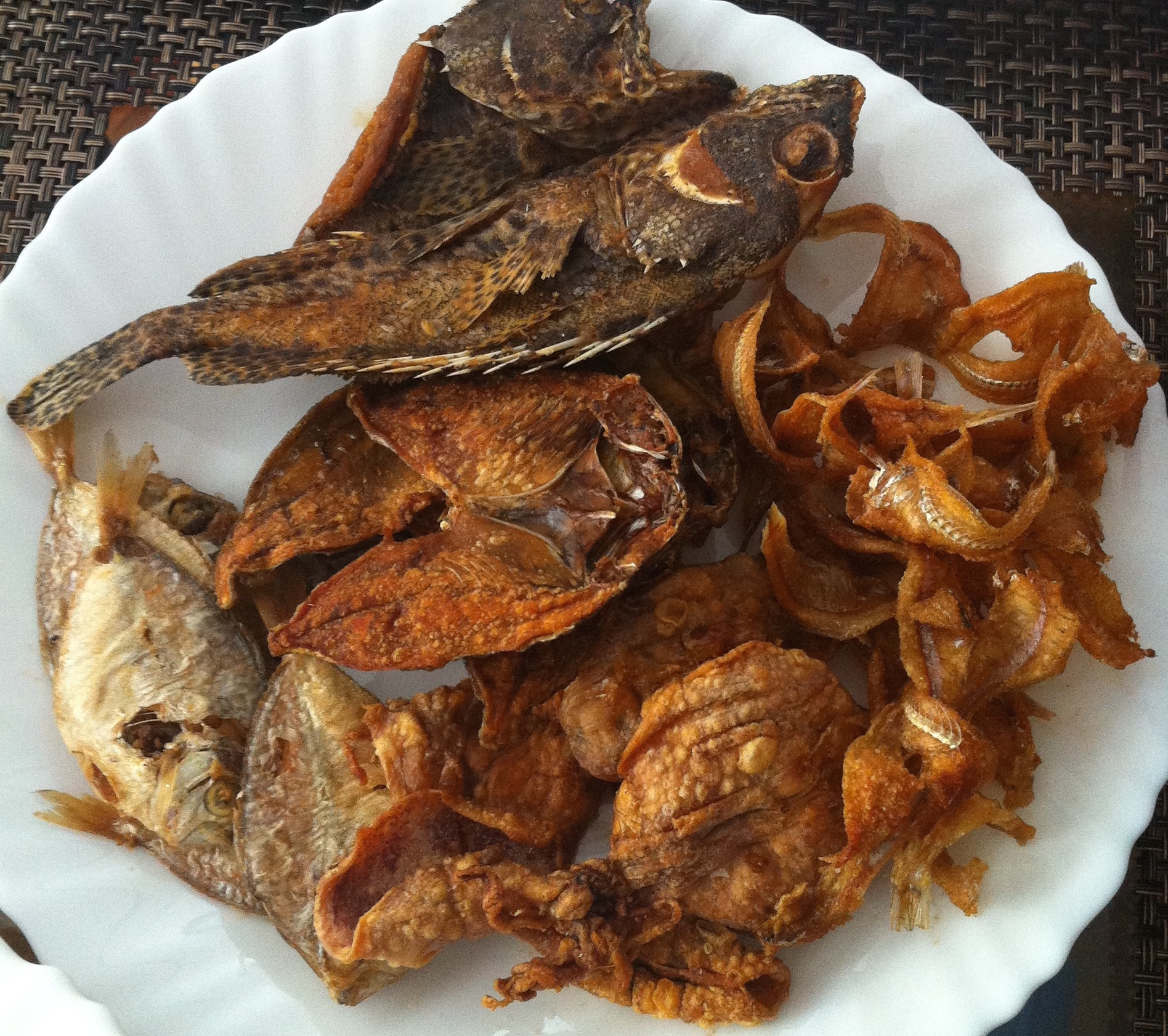 A variety of dried fish and squids. These are delicious dipped in vinegar sauces and/or grilled.