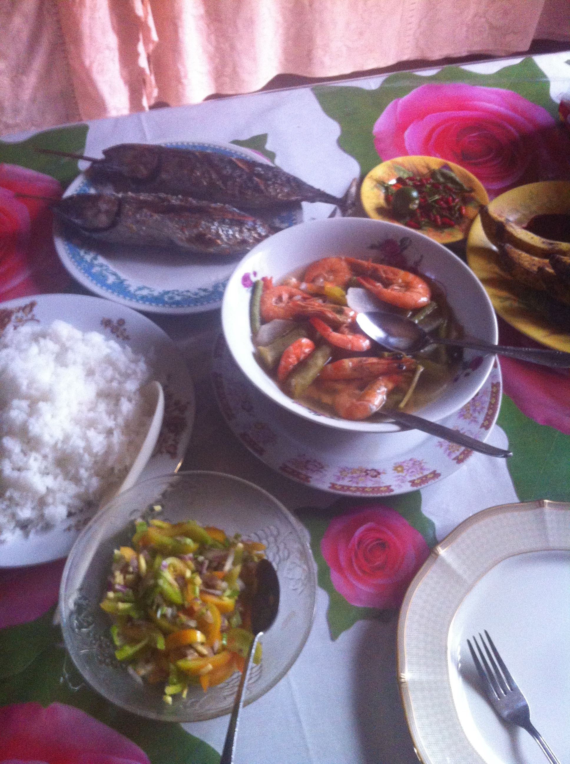 Lunch on the island ofNegros Orientales: grilled fish, prawn sinigang, and tomato/ginger/chili salad. Yum!