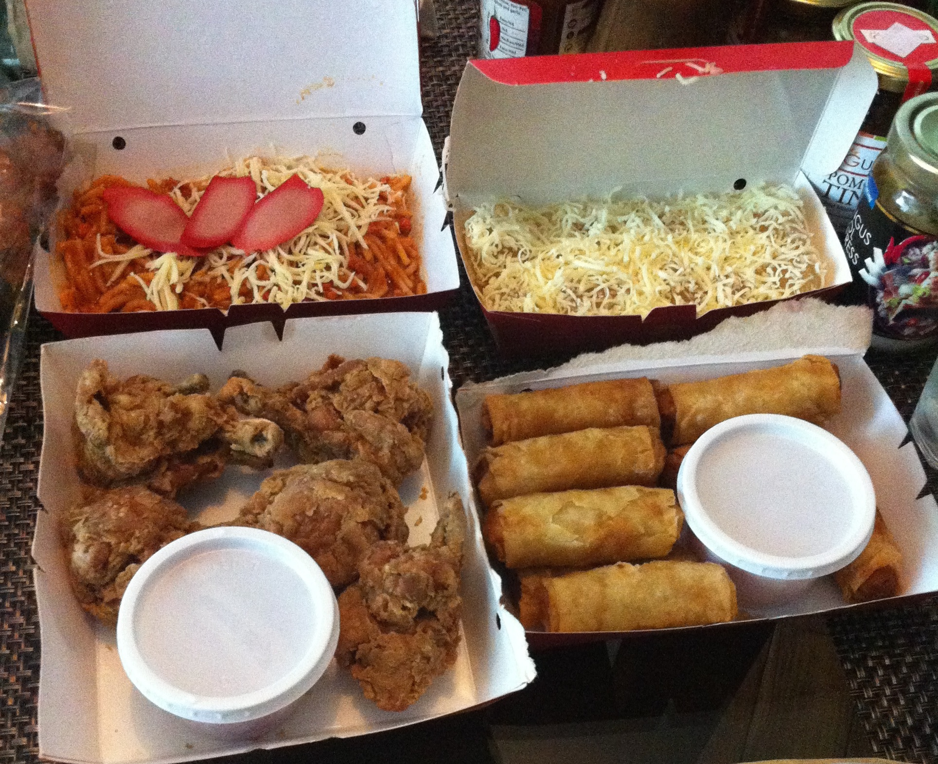 Popular fast food: Filipino spaghetti, fried chicken, lumpia( summer rolls ), and pichi pichi -- a steamed cassava dessert, this time covered in cheese.