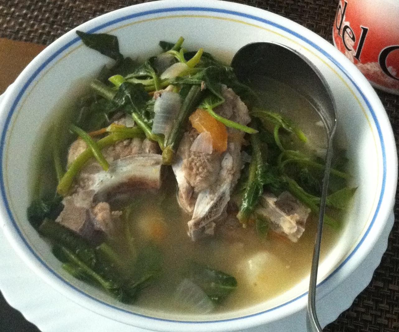 Sinigang: the ubiquitoussour tamarind soup, a Filipino classic.