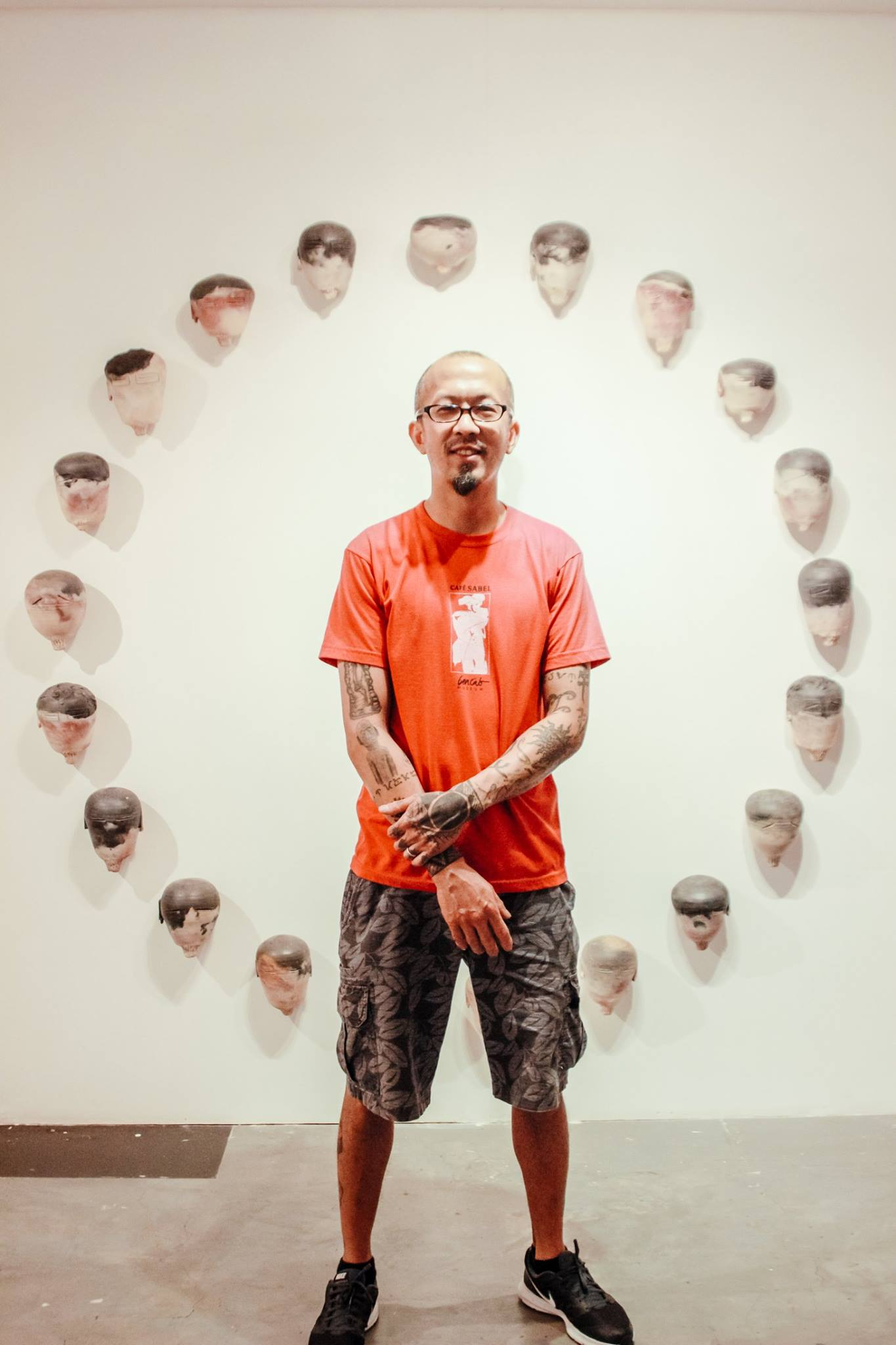 Hadrian Mendoza standing in front of his piece entitled Maitum Circle during his exhibition show at 856G Gallery, Homage.