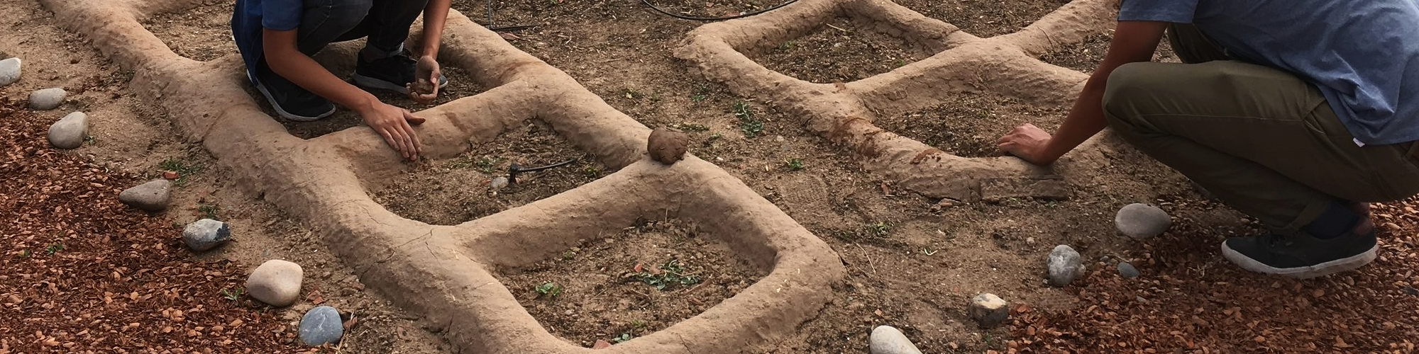 Cultural Education staff forms adobe waffle beds in the Indian Pueblo Cultural Center's Resilience Garden, April 2017