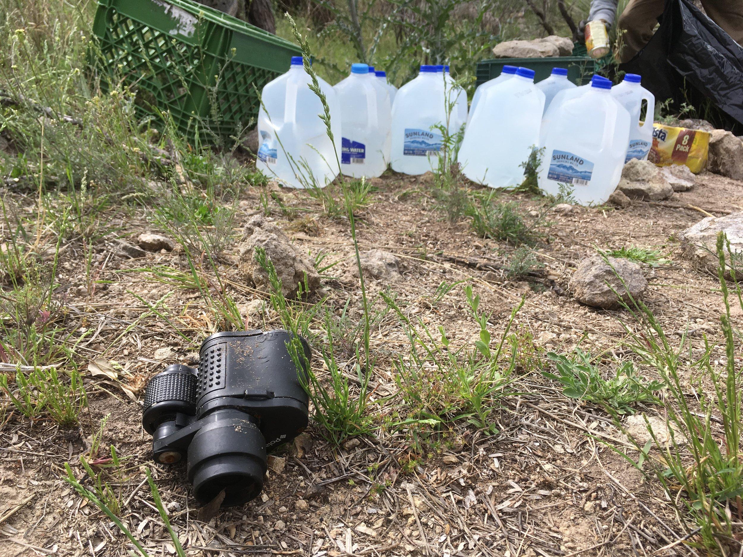 Broken binoculars abandoned at a drop point
