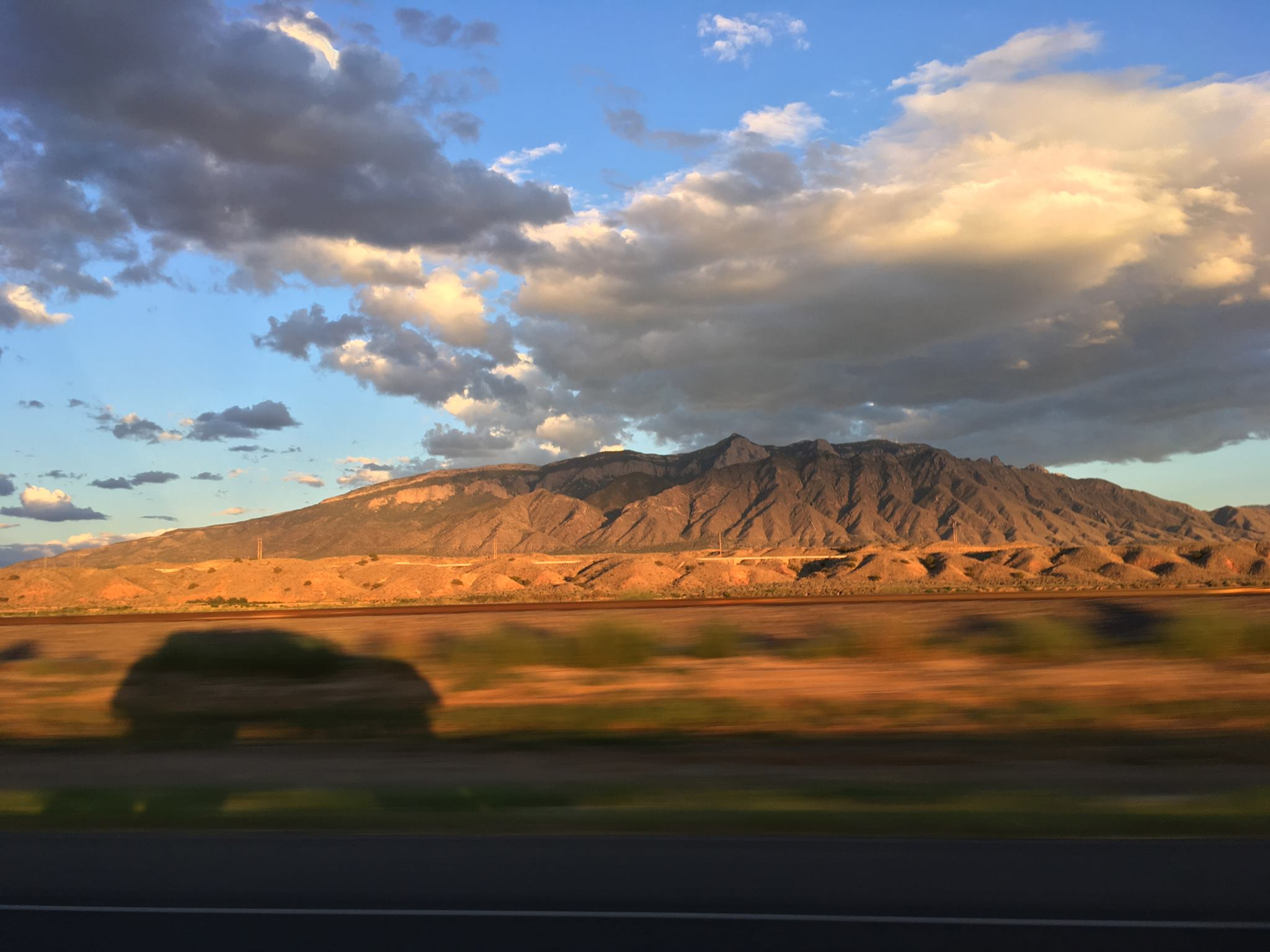 """""""The View From New Mexico"""" Published by  The Policy  Sep 30, 2019  On the night of Trump's campaign rally in Rio Rancho, I was fifteen minutes away from the venue, working late. I forgot Air Force One had landed at the Albuquerque Sunport until I drove home on I-25 southbound and passed police car after police car. They were parked at each on-ramp, blue and red lights sparkling like continuous patriotic fireworks in the black of night.  […]"""