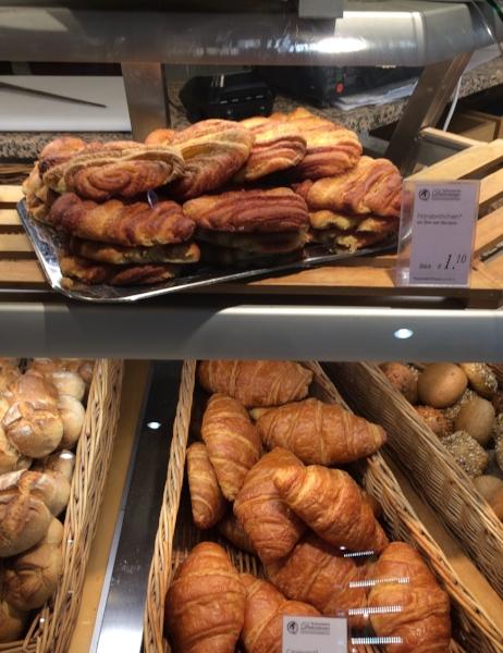 normal croissants on bottom, 2D croissant-like Leckere Franzbrötchen on top