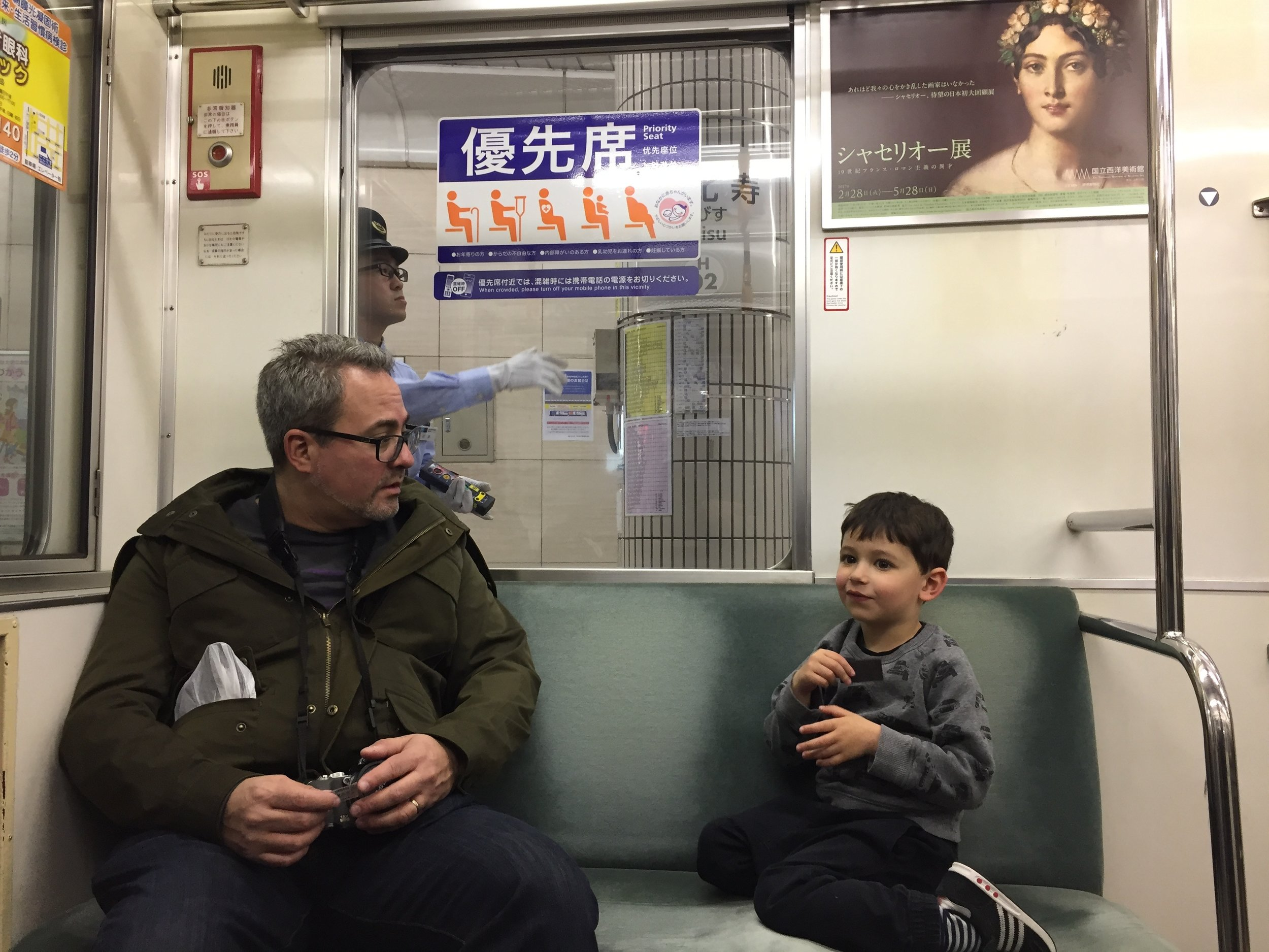 in the metro,ender tells uncle dave about the in-field fly rule so he doesn't embarrass us at the game