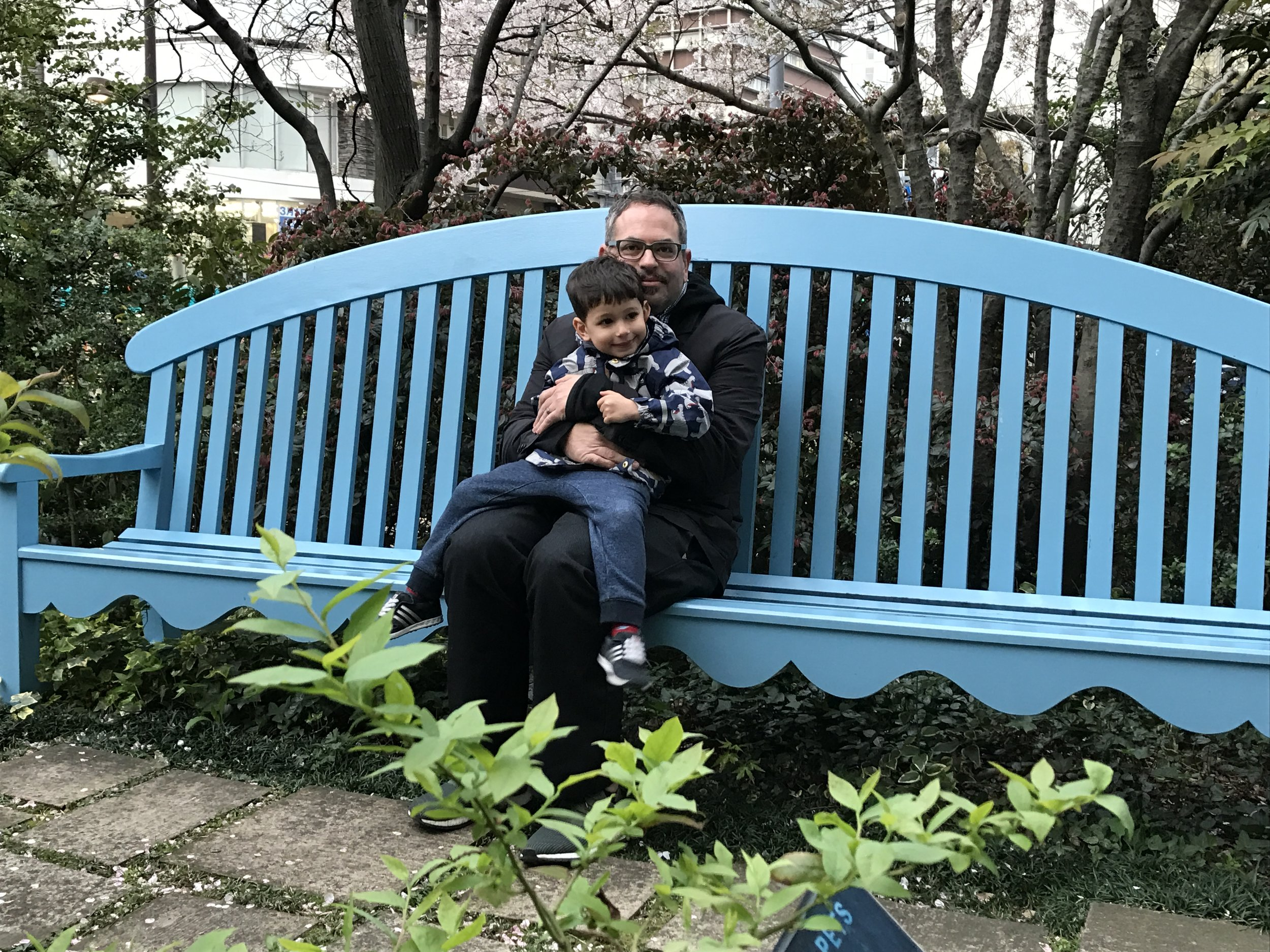 going out after a nap, we find a tiny blue bench