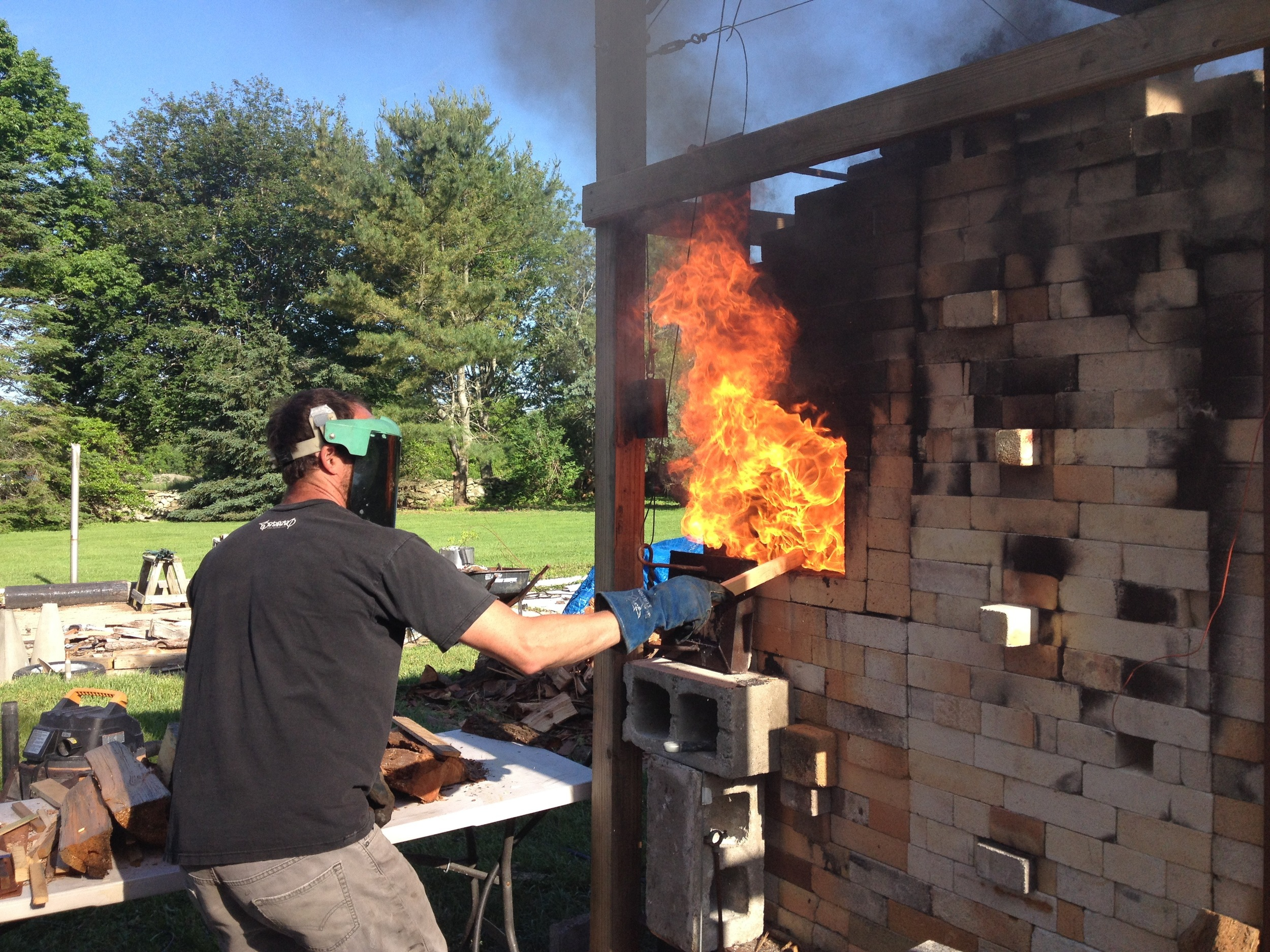 Charlie firing the hybrid wood/soda/gas kiln he built at his home in Little Compton.