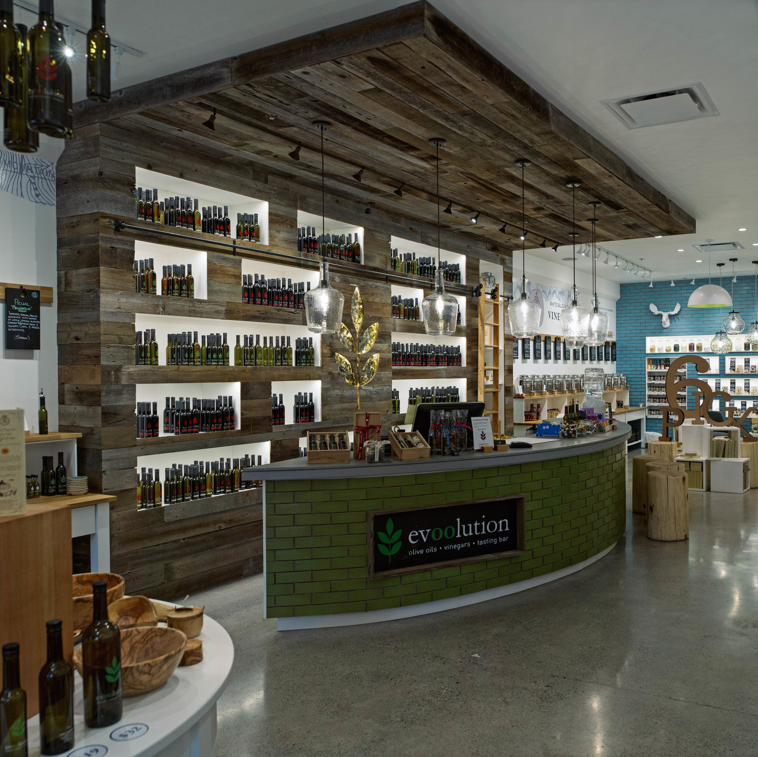 Evoolution Canmore:   This 1,400ft2 new olive oil and vinegar retail store and tasting bar was designed by Kaben Design.   This store incorporated high end, reclaimed and sustainable finishes to deliver and absolutely stunning and busy store to Main St. in Canmore, AB.  ACS was involved from day one to help conceive the budget and schedule, ensure it was in line with the owners expectations and ultimately deliver on time and on budget.
