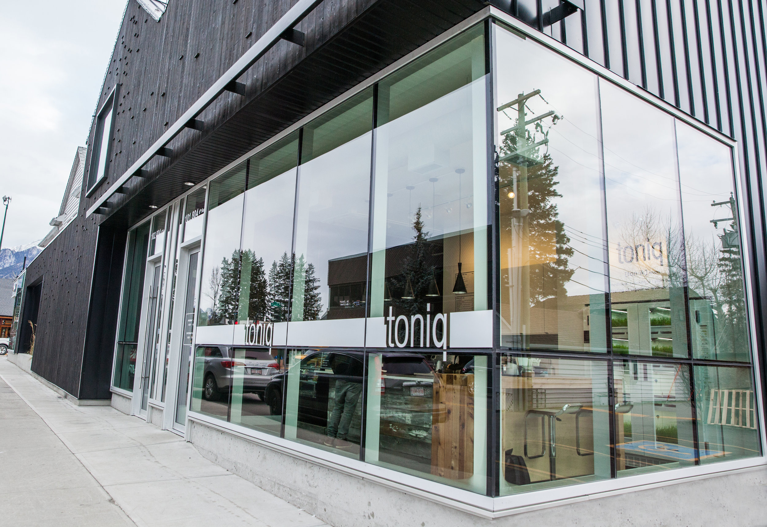 Toniq:   This tenant improvement to a 650ft2 unit in the newly constructed Tinbox Building in Downtown Canmore consisted of a retail location with a production raw food kitchen located in behind.  ACS worked with the owner to coordinate the design and finishes and bring the owner's dreams to life.   ACS design-built and implemented with the selected sub-contrators the HVAC, mechanical and electrical scopes of work as well as supplied and installed the custom finish carpentry and millwork.