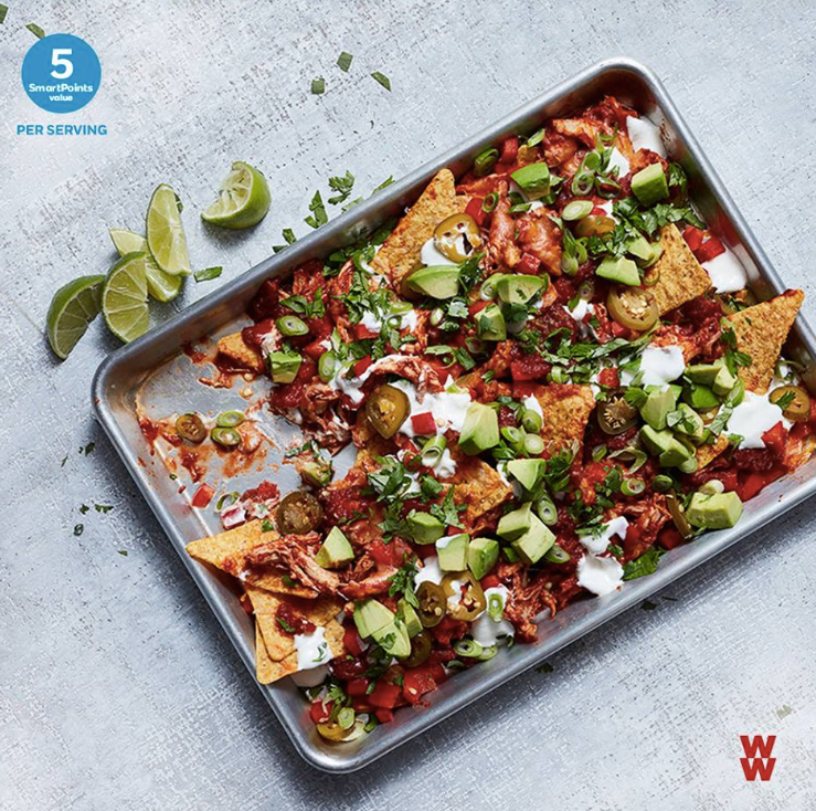 """Whether it's  #TacoTuesday  or you're throwing a fiesta, these Chipotle-Pulled Chicken Nachos featuring  #WW  reduced fat Mexican blend shredded cheese are crowd pleasers! (5 SPV per serving)."""