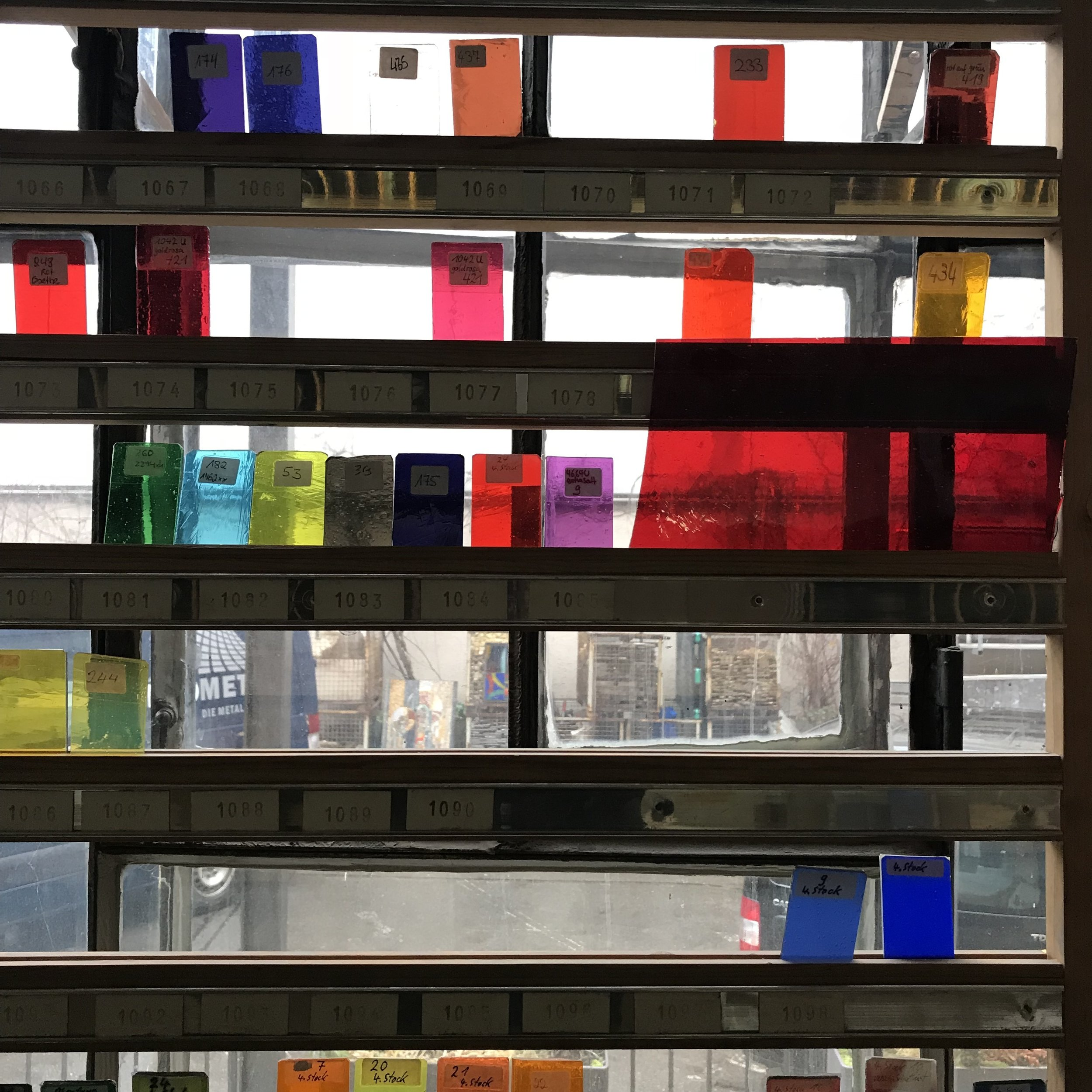 Hand-blown colored glass samples.