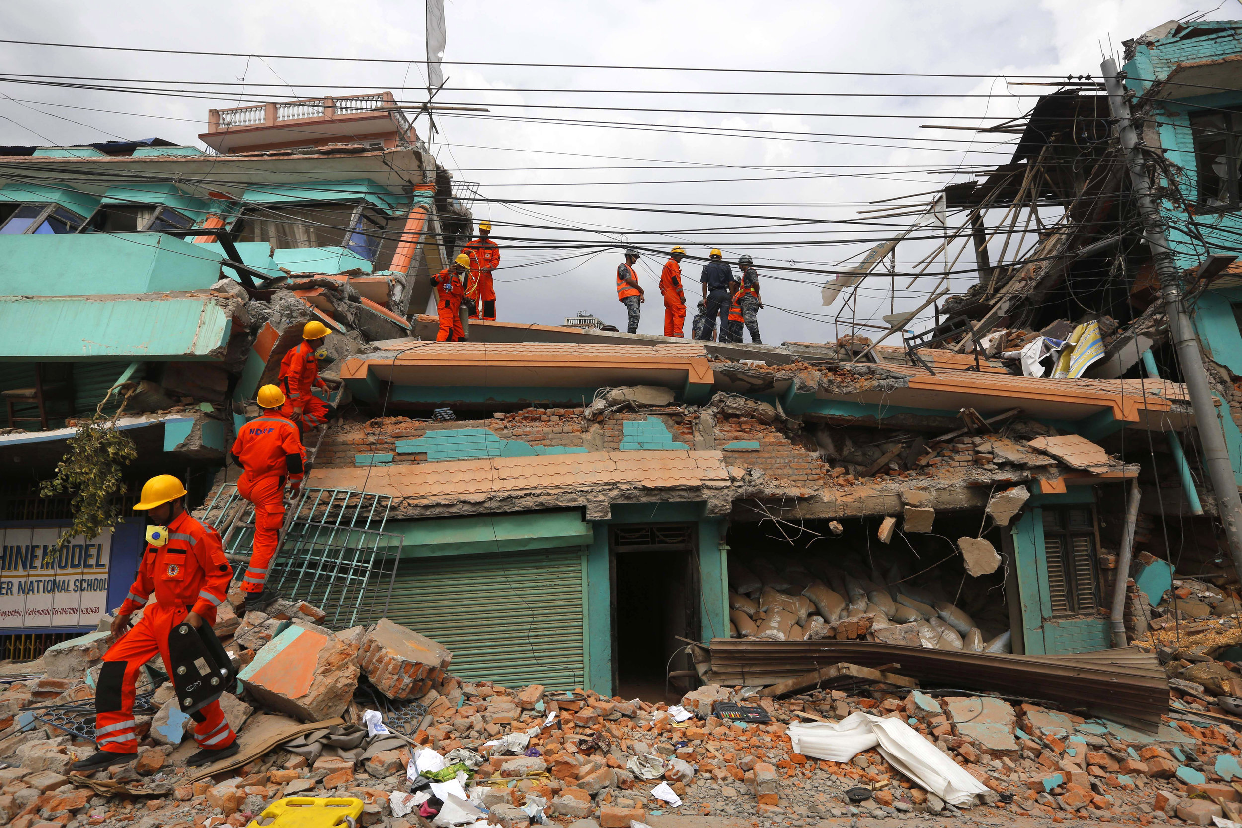 India's National Disaster Response Force personnel look for survivors in a building in Kathmandu on April 26.       (Photo: Manish Swarup, AP)
