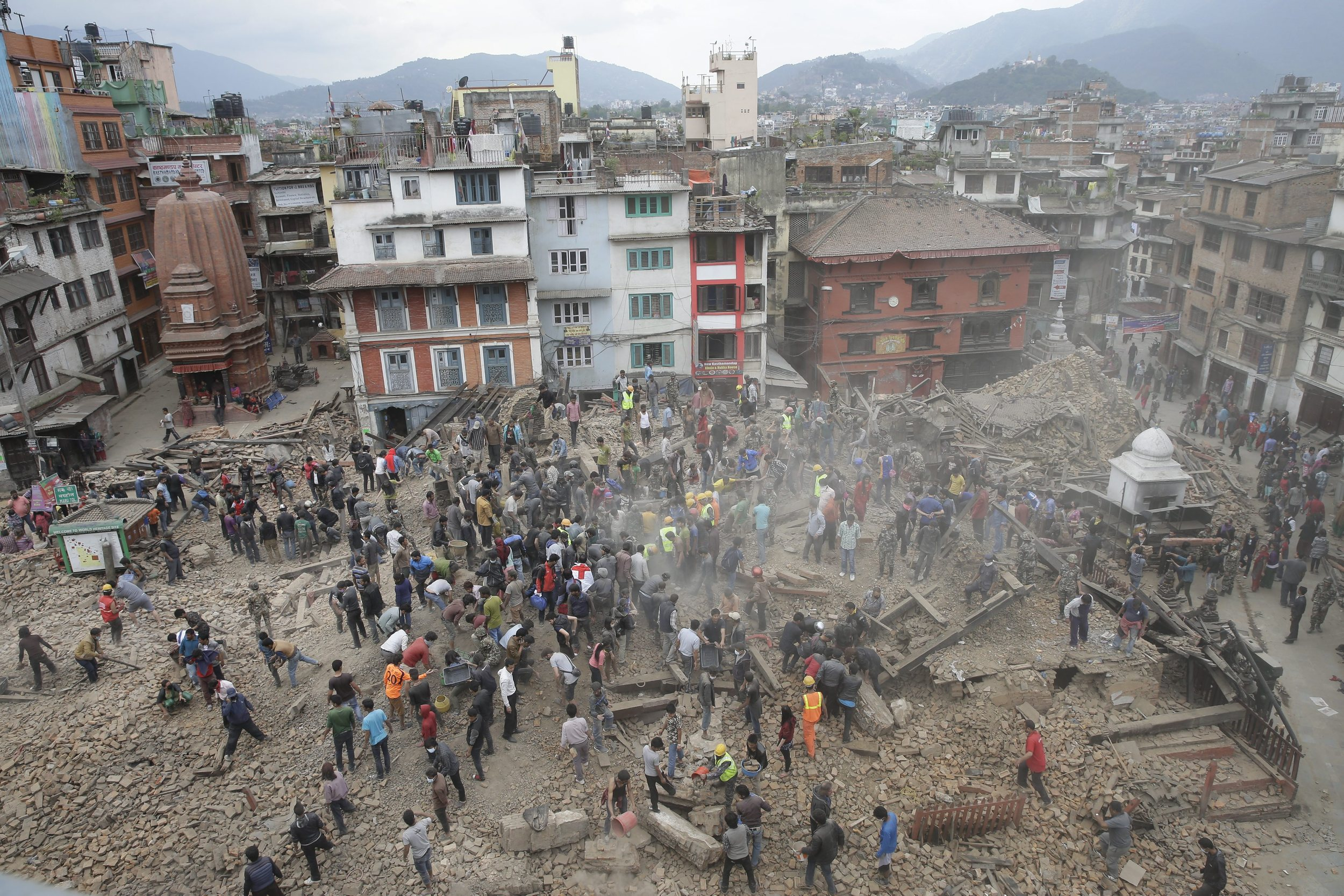 People search for survivors under the rubble of collapsed buuildings in Kathmandu's Durbar Squae.     (Photo: Narendra Shrestha, European Pressphoto Agency)
