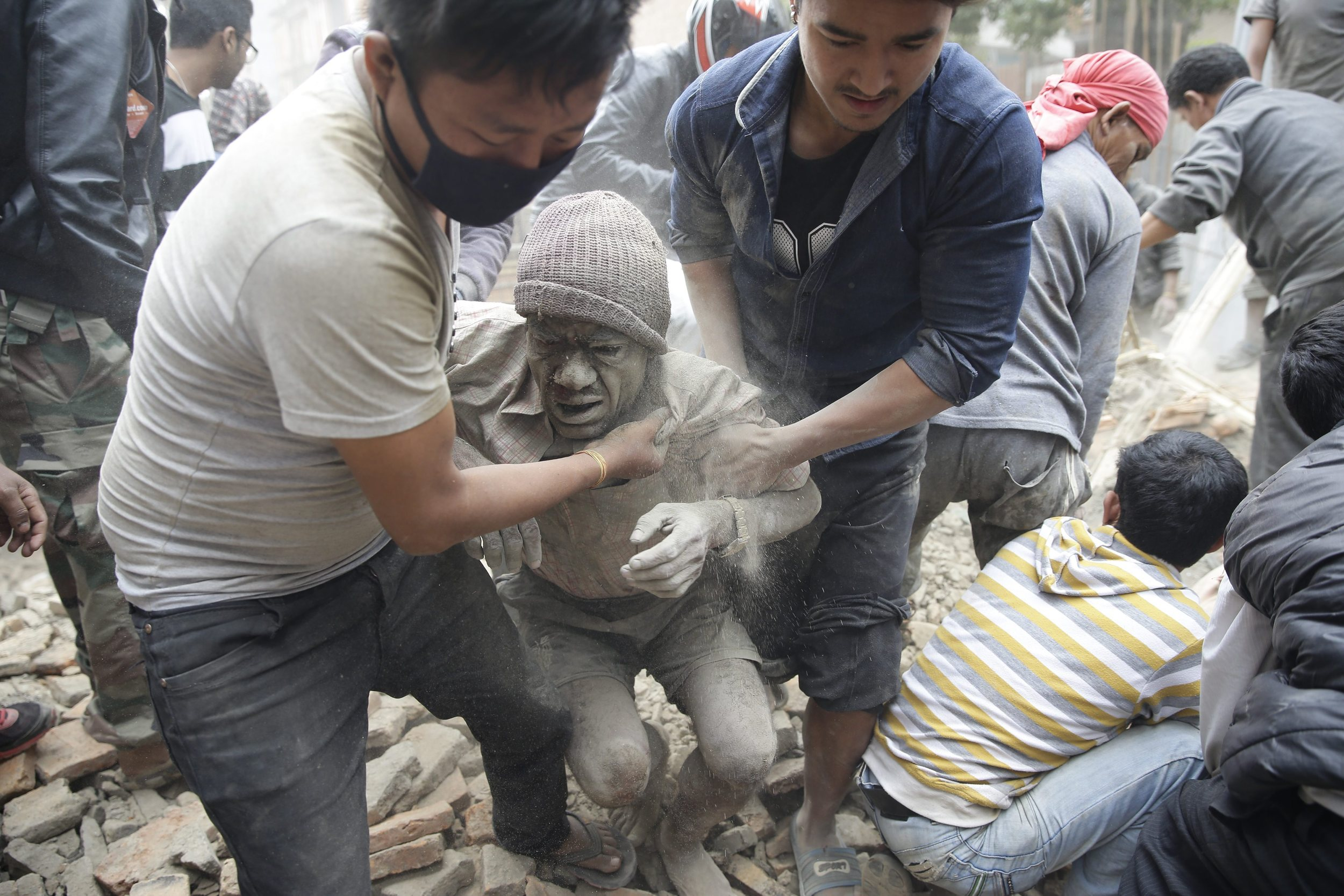 People free a man from the rubble of a destroyed building.     (Photo: Narendra Shrestha, European Pressphoto Agency)