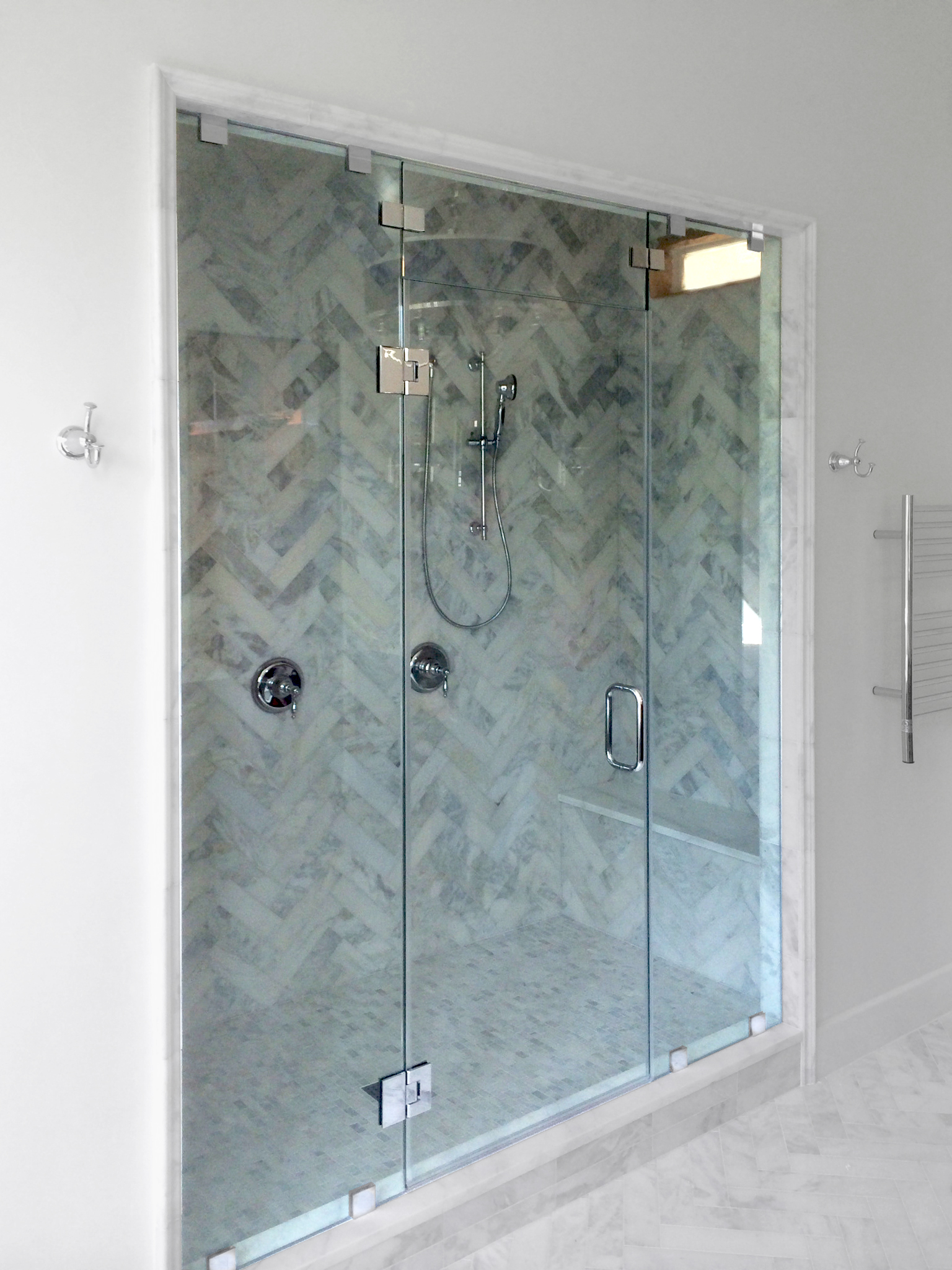 #14.  An elegant example of a three-piece inline steam shower with transom.