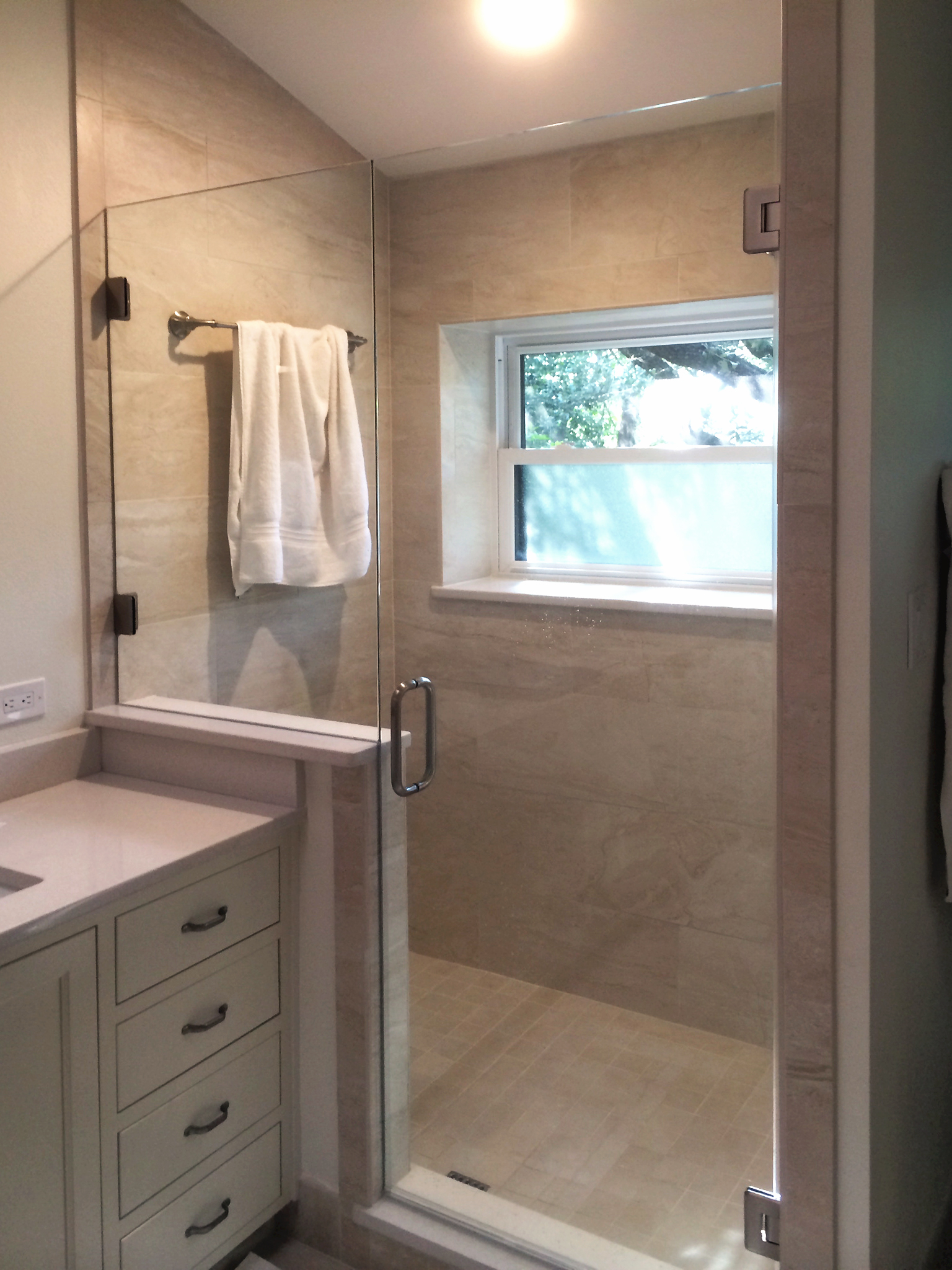 #15.  Simplicity at its best – a frameless shower door with inline panel lends this space a zen-like serenity.