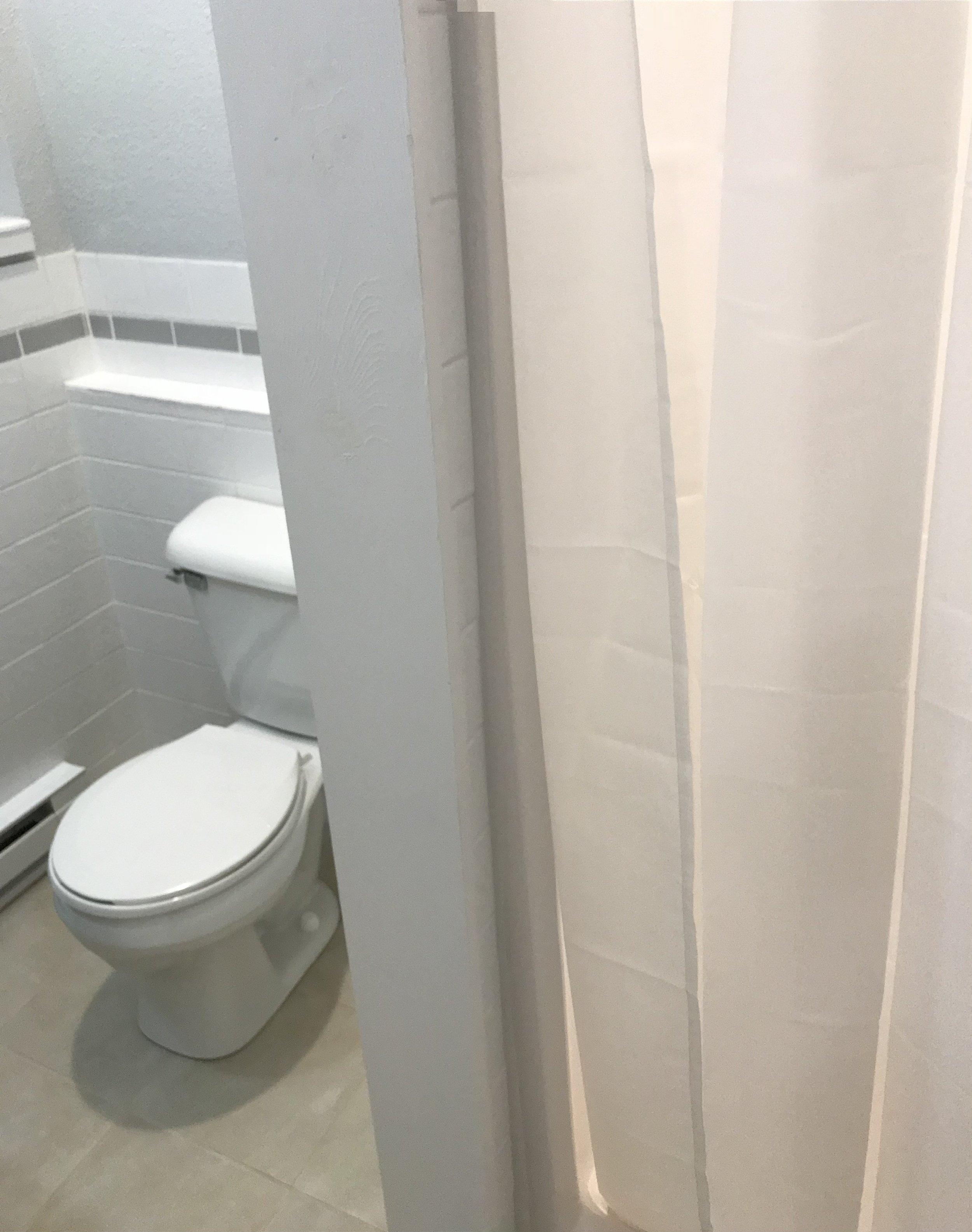 Tiled Bathroom.   One Piece Shower.
