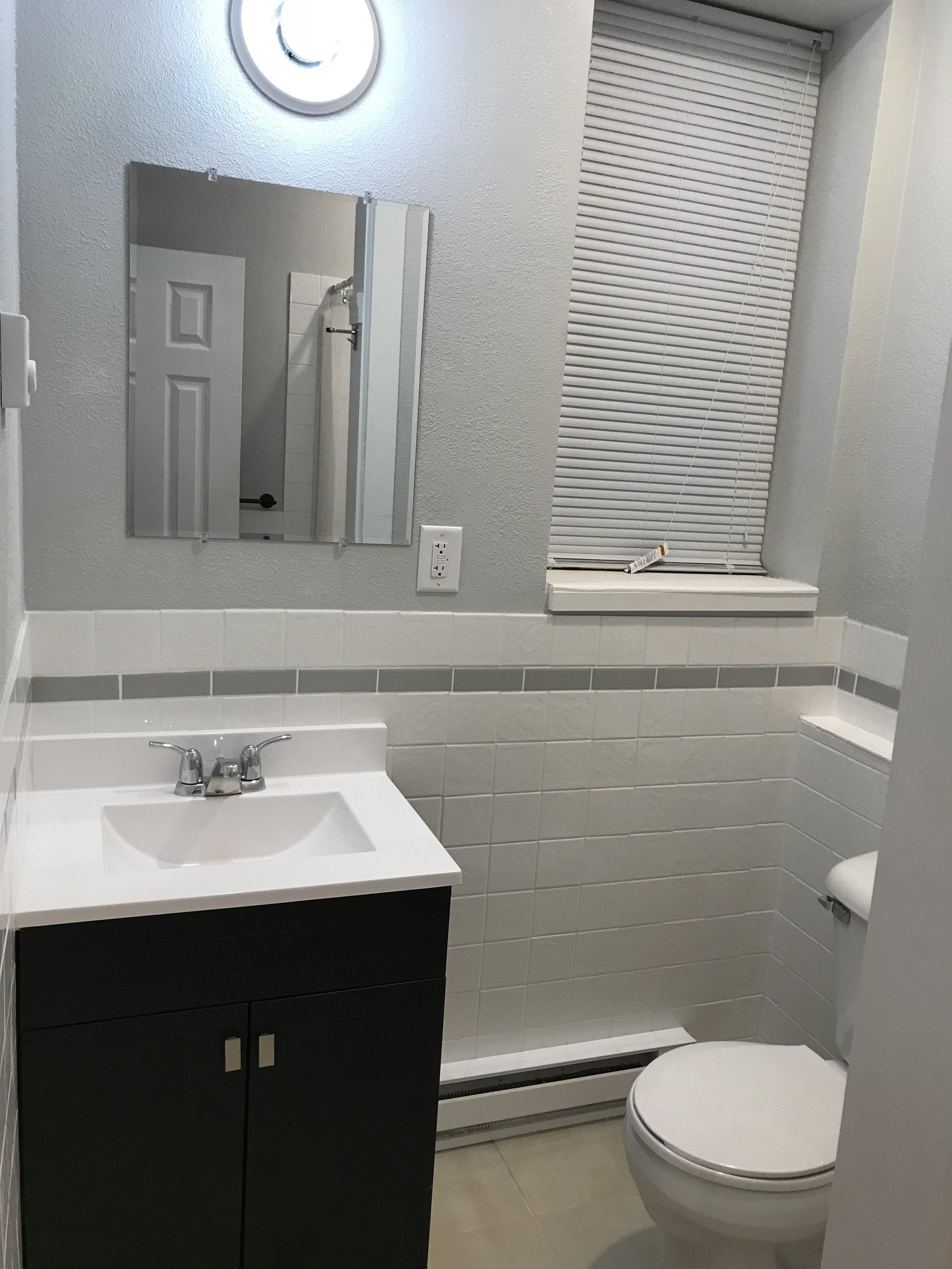 Bath.  Wooden Vanity with Solid Top