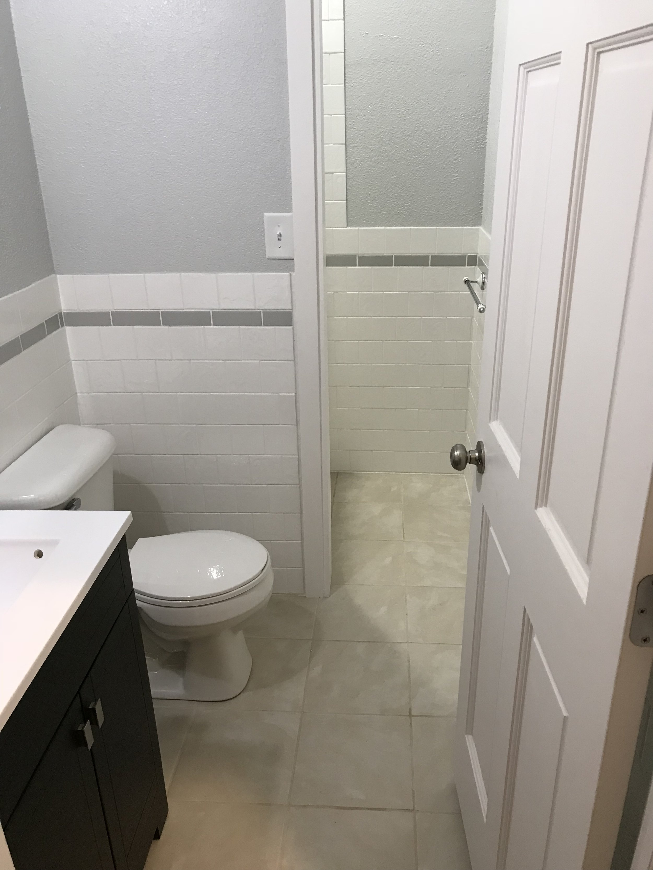 Bath with tiled walls