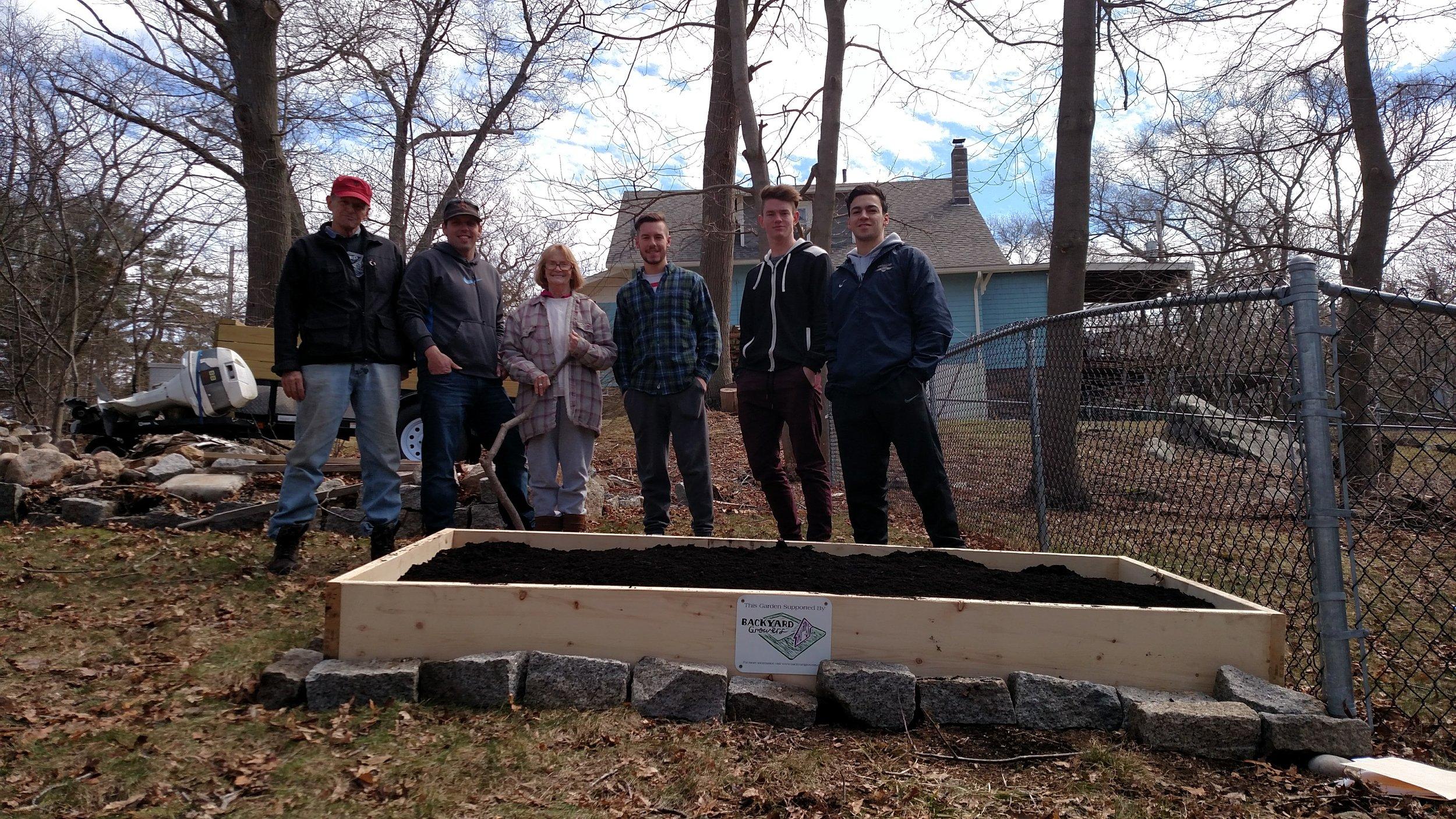 Endicott College Soccer team helped build Pat's garden bed.