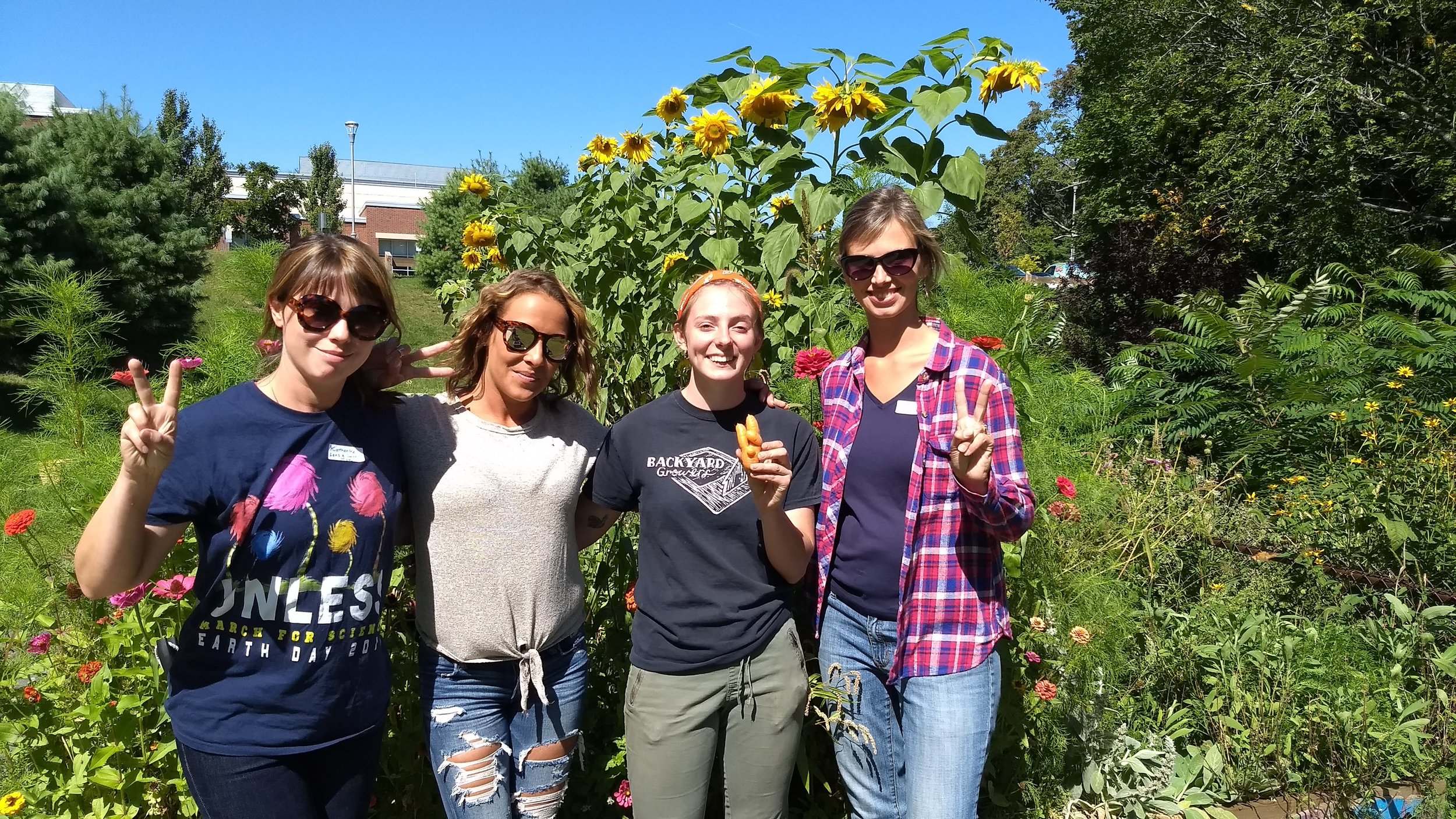 Emily Brown with parent volunteers during BYG's Fall Harvest Days