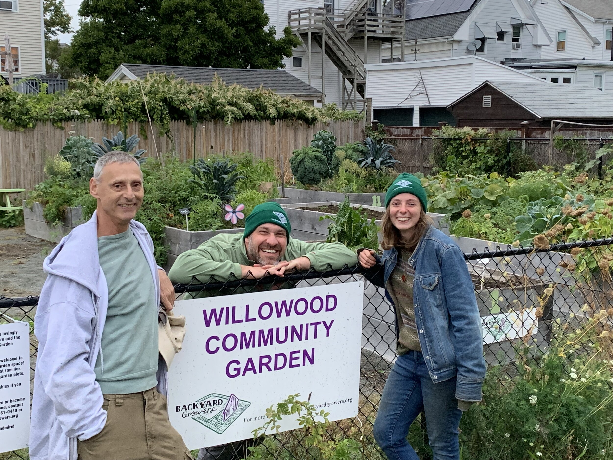 Garden Mentors Peter DeNigris, left, and Joel Emerson, center, with 2019 FoodCorps Service Member Emily Brown, right.