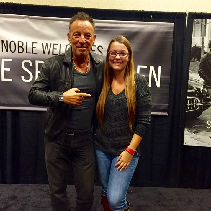 Bruce Springsteen points at a book signing attendee.