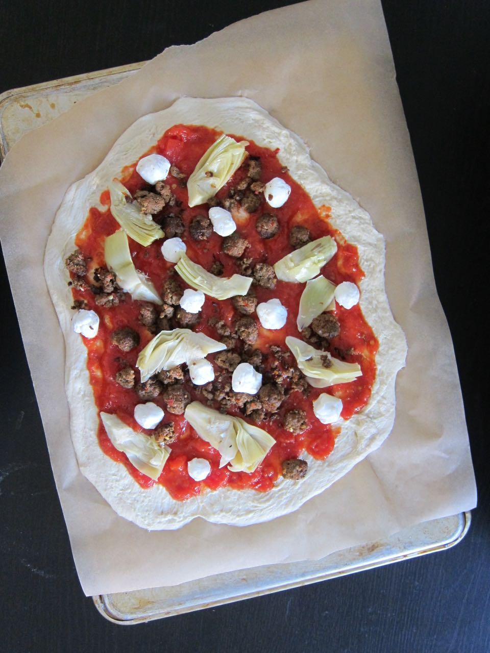 unbaked Merguez pizza