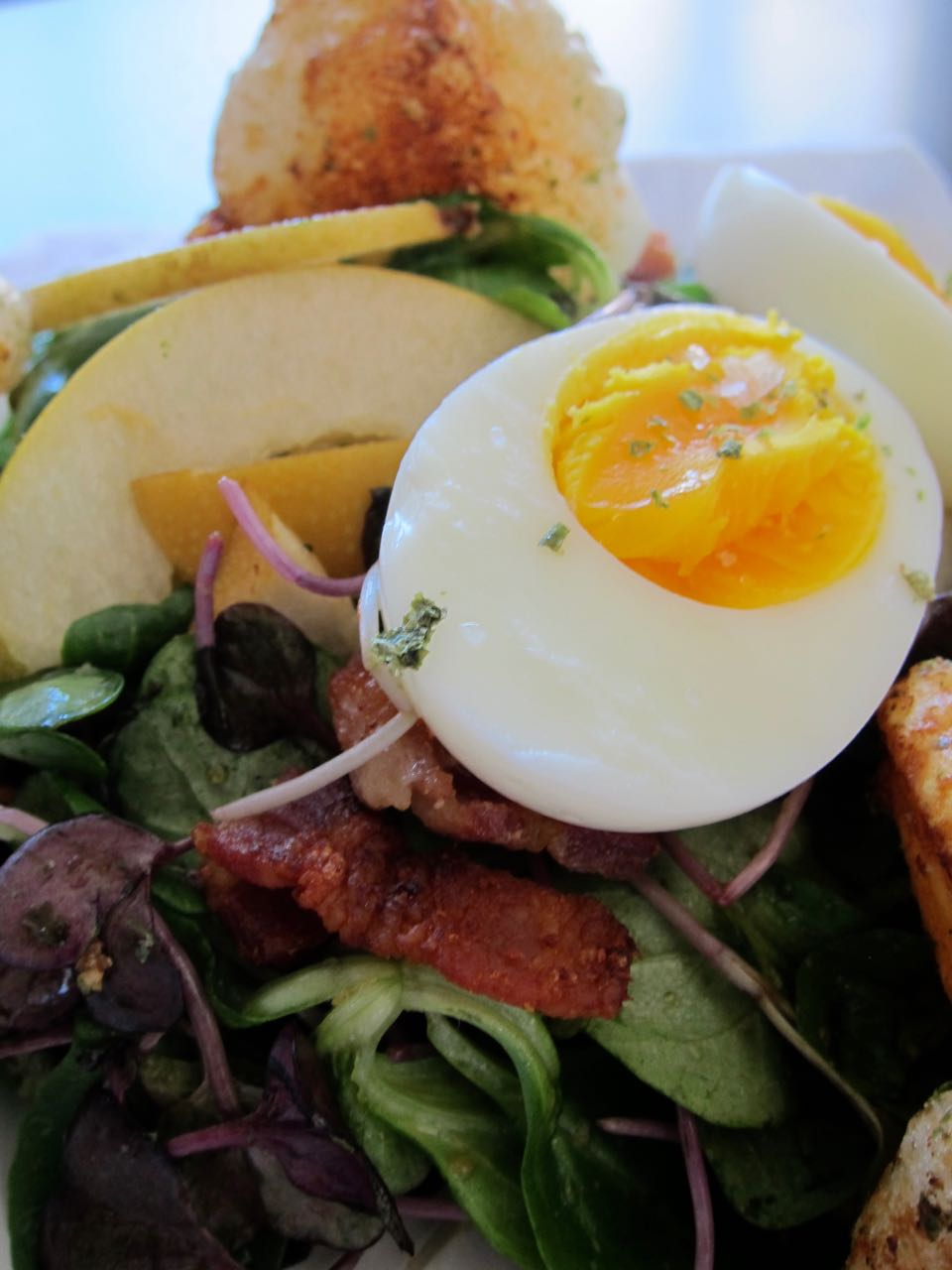Mochi Crouton Salad topped with an egg