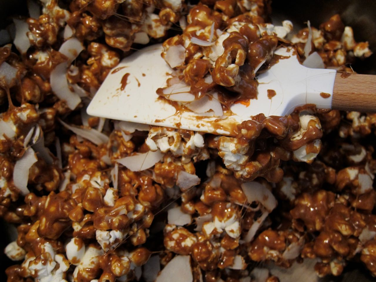 mixing coconut curry caramel corn
