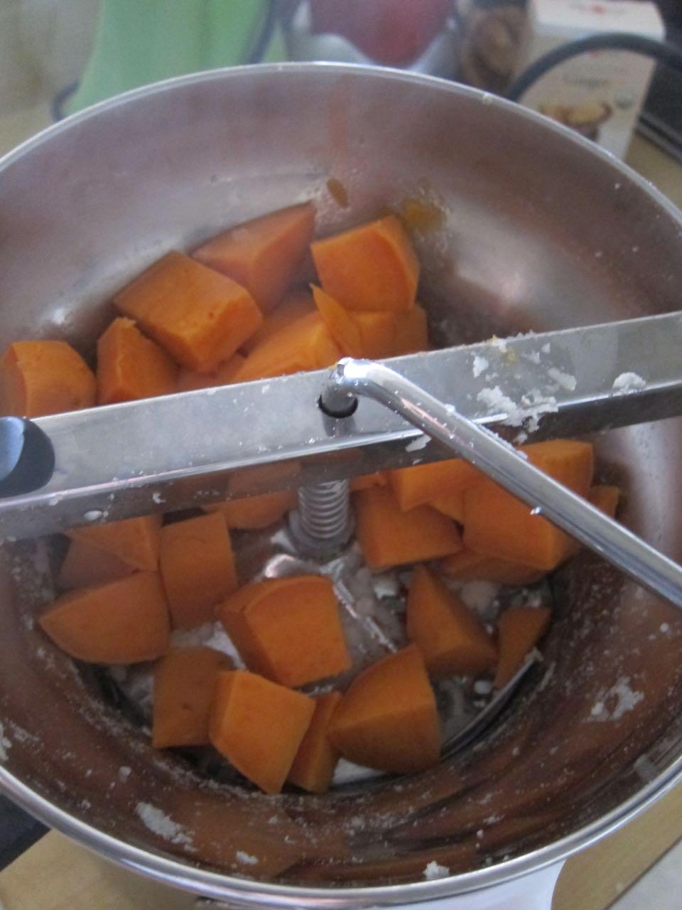 mashing sweet potatoes.jpg