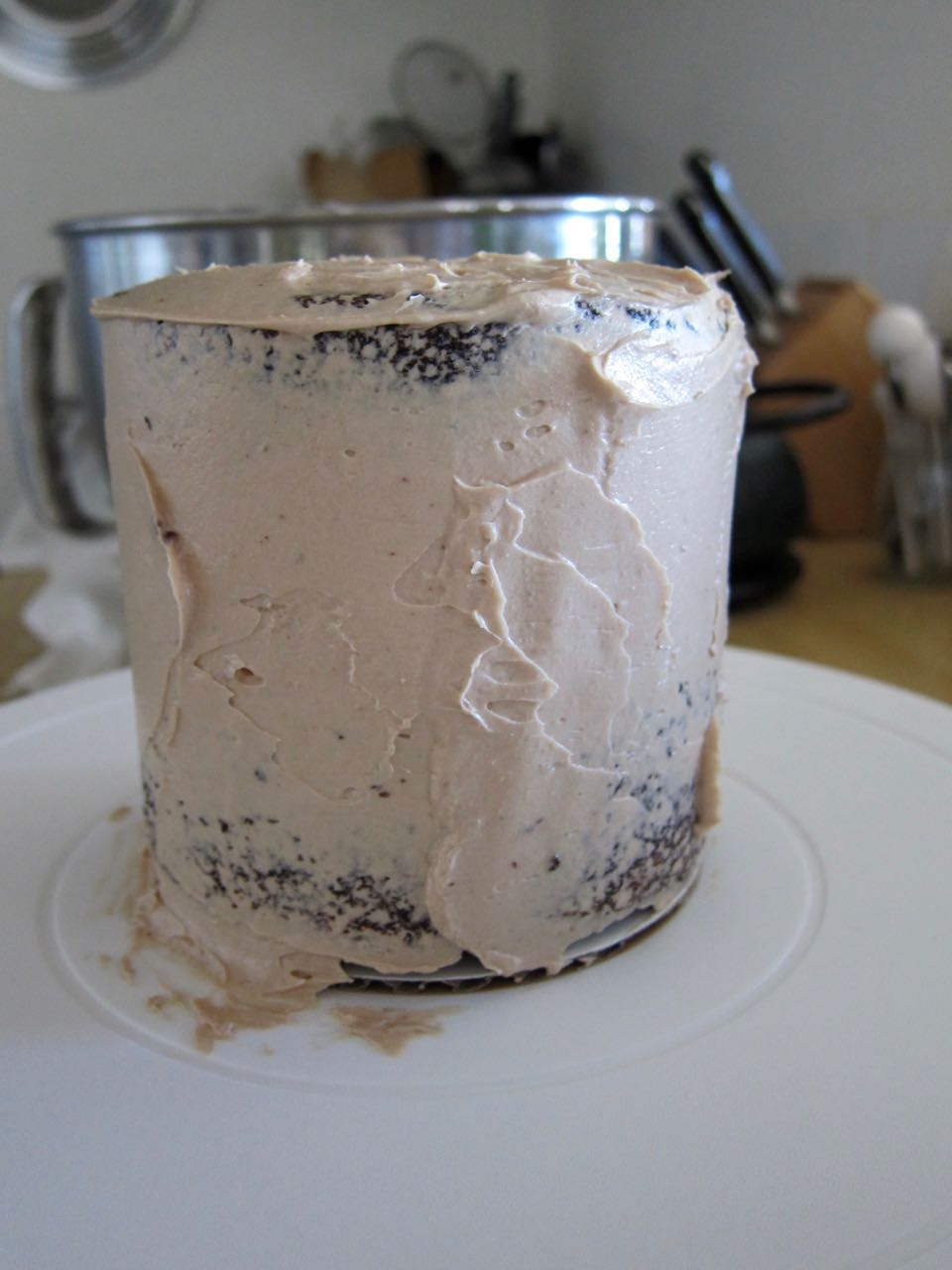 tahini chocolate frosting crumb coat.jpg
