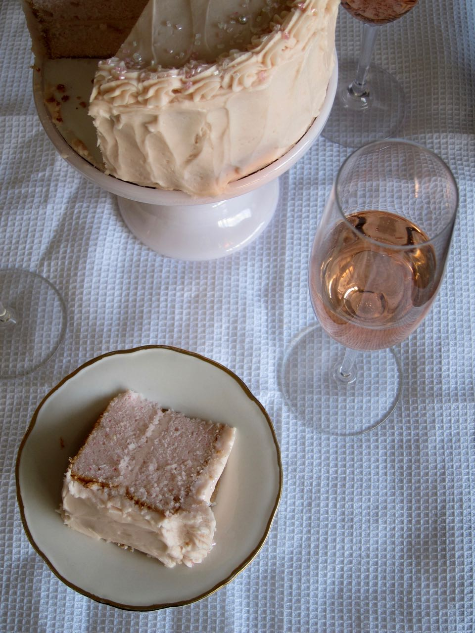 sliced pink champagne cake and pink champagne.jpg