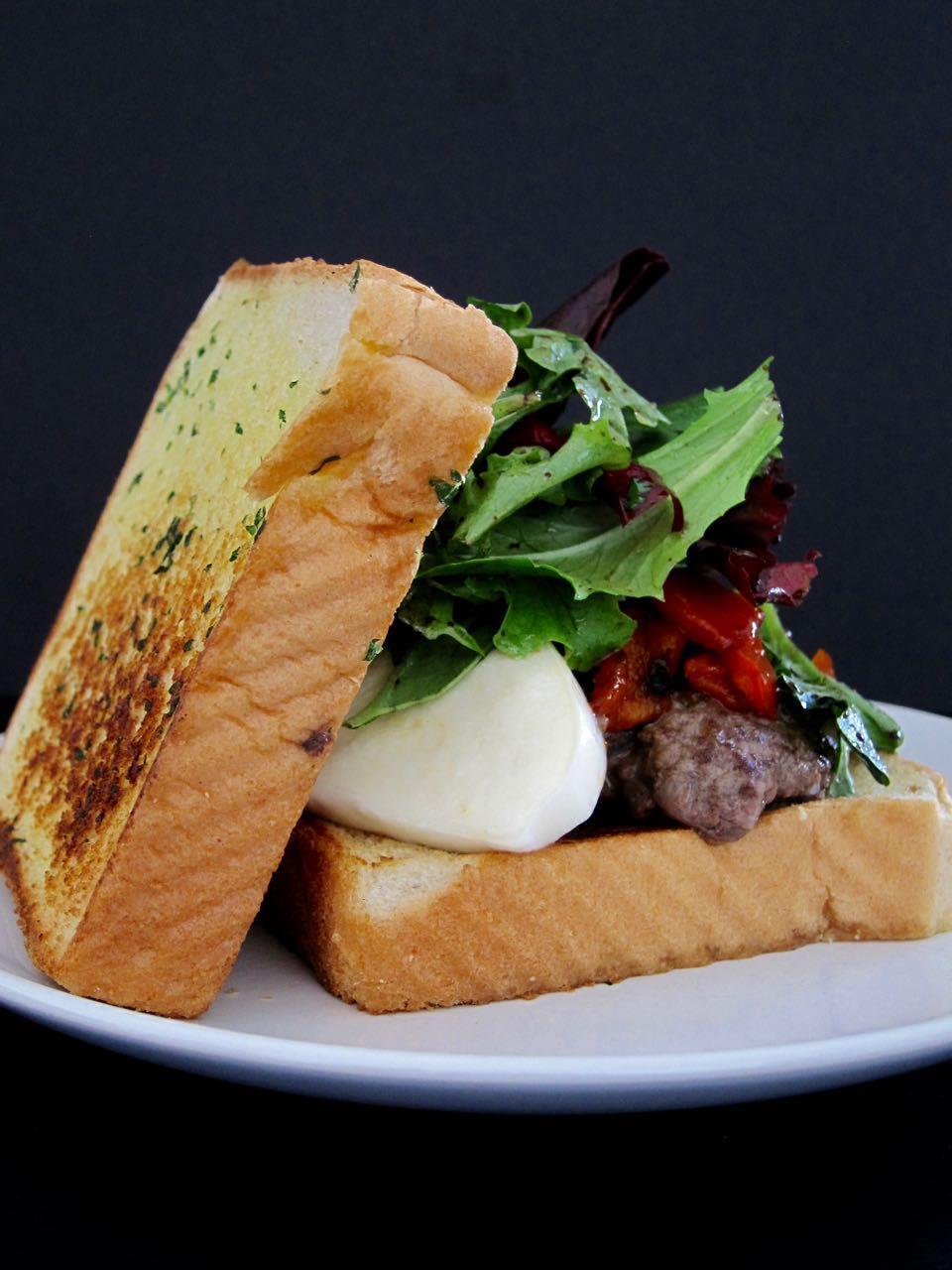 bruschetta burger on garlic toast