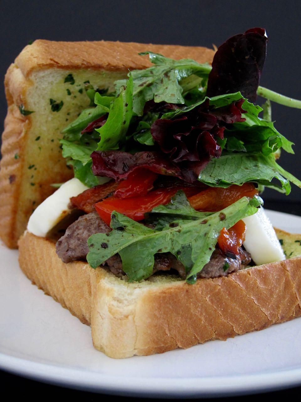 bruschetta burger on thick garlic toast