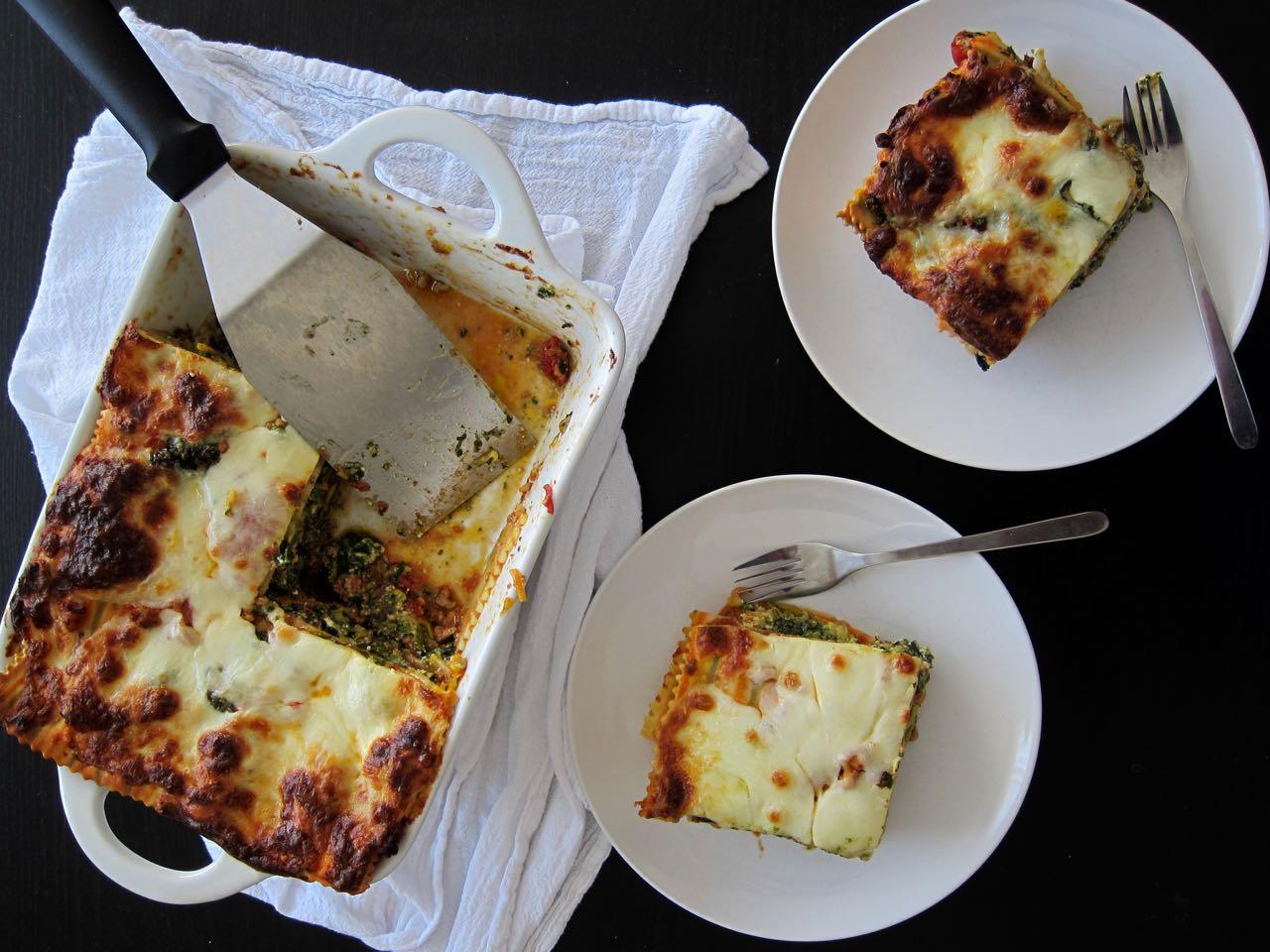 serving veggie & chicken lasagna